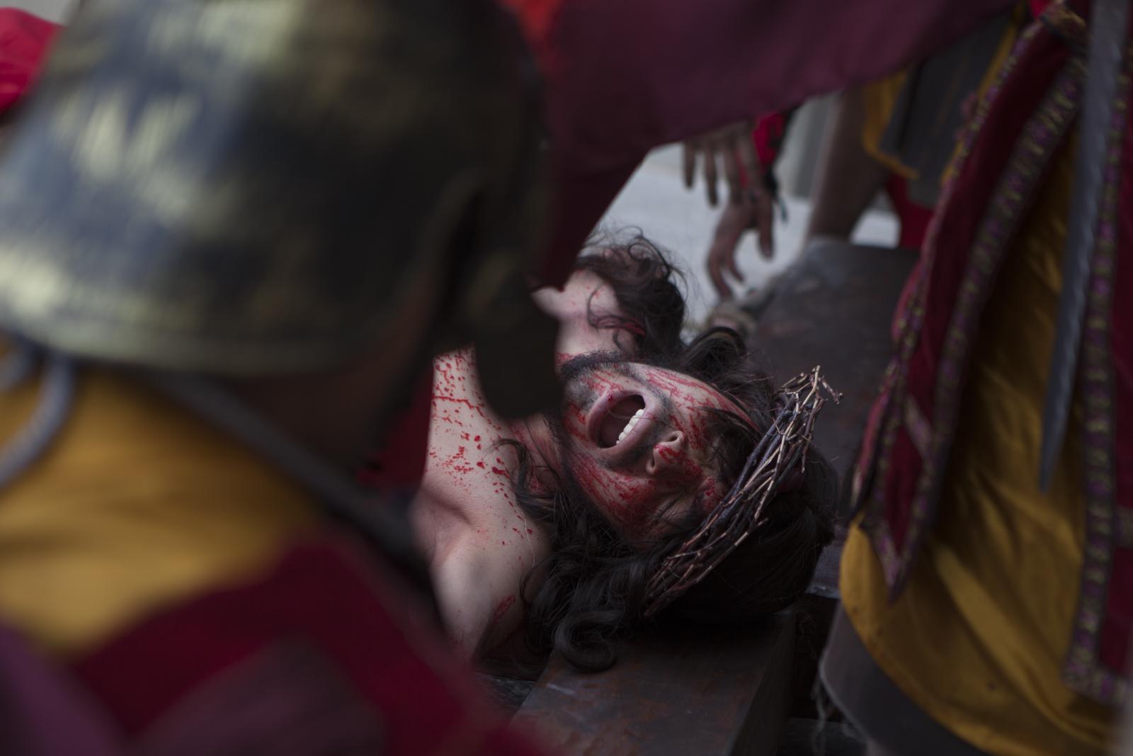 Elmer Ventura, as Jesus, is crucified.