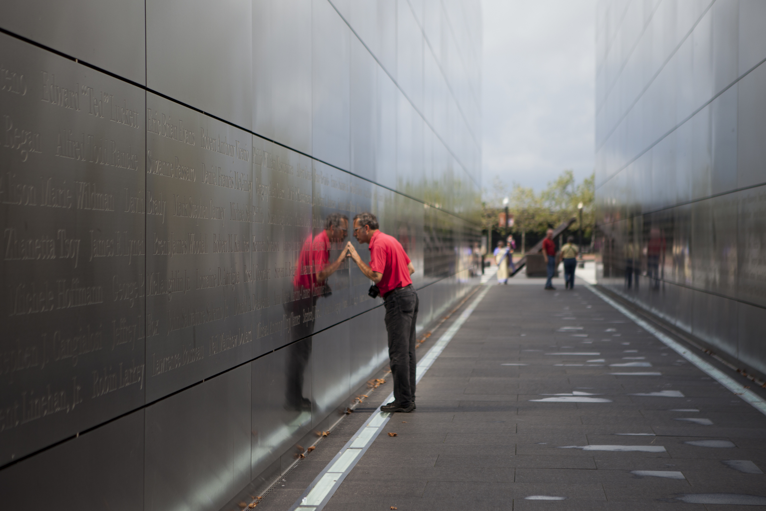 Ray Hoyt, from Mississippi, touches a name on the memorial. New Jersey's September 11th memorial, titled Empty Sky, is located in Liberty State Park in Jersey City.