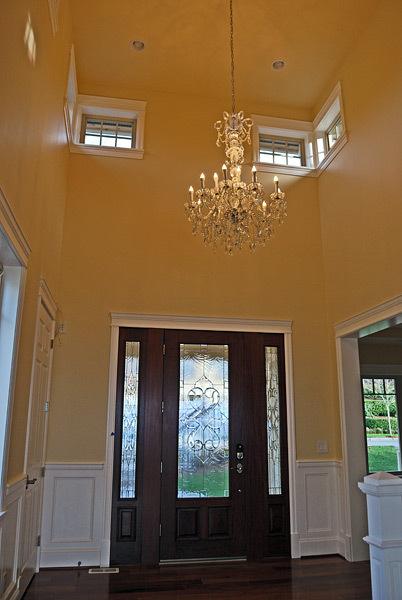 Kapadia Residence Front Door Entryway with Chandelier - Tatiana Hisel Interior Design