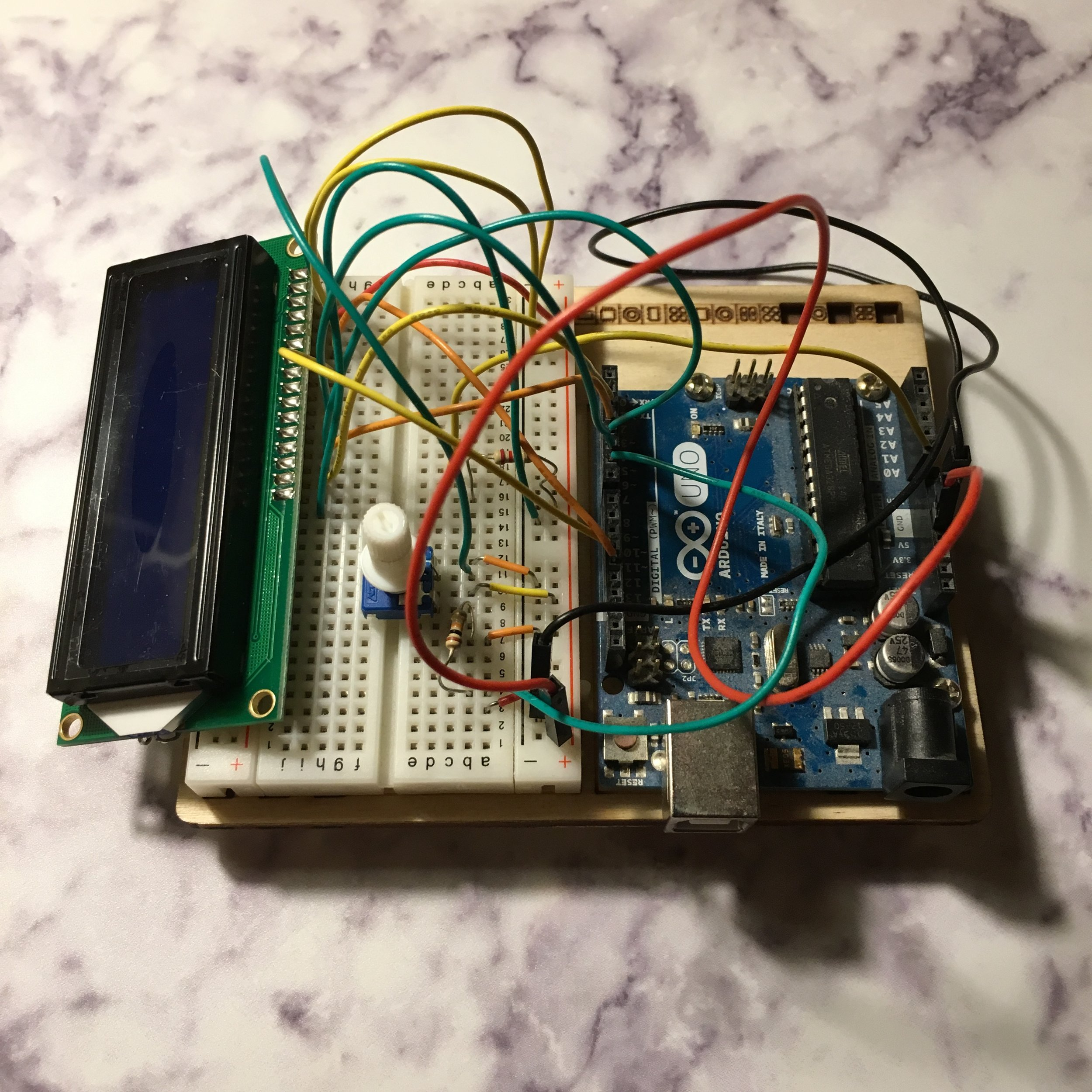 Work in progress: A little device to tell the future. The 'Crystal Ball' board wiring on the Arduino. Eventually, a series of answers will appear on the screen to tell us what the future holds.