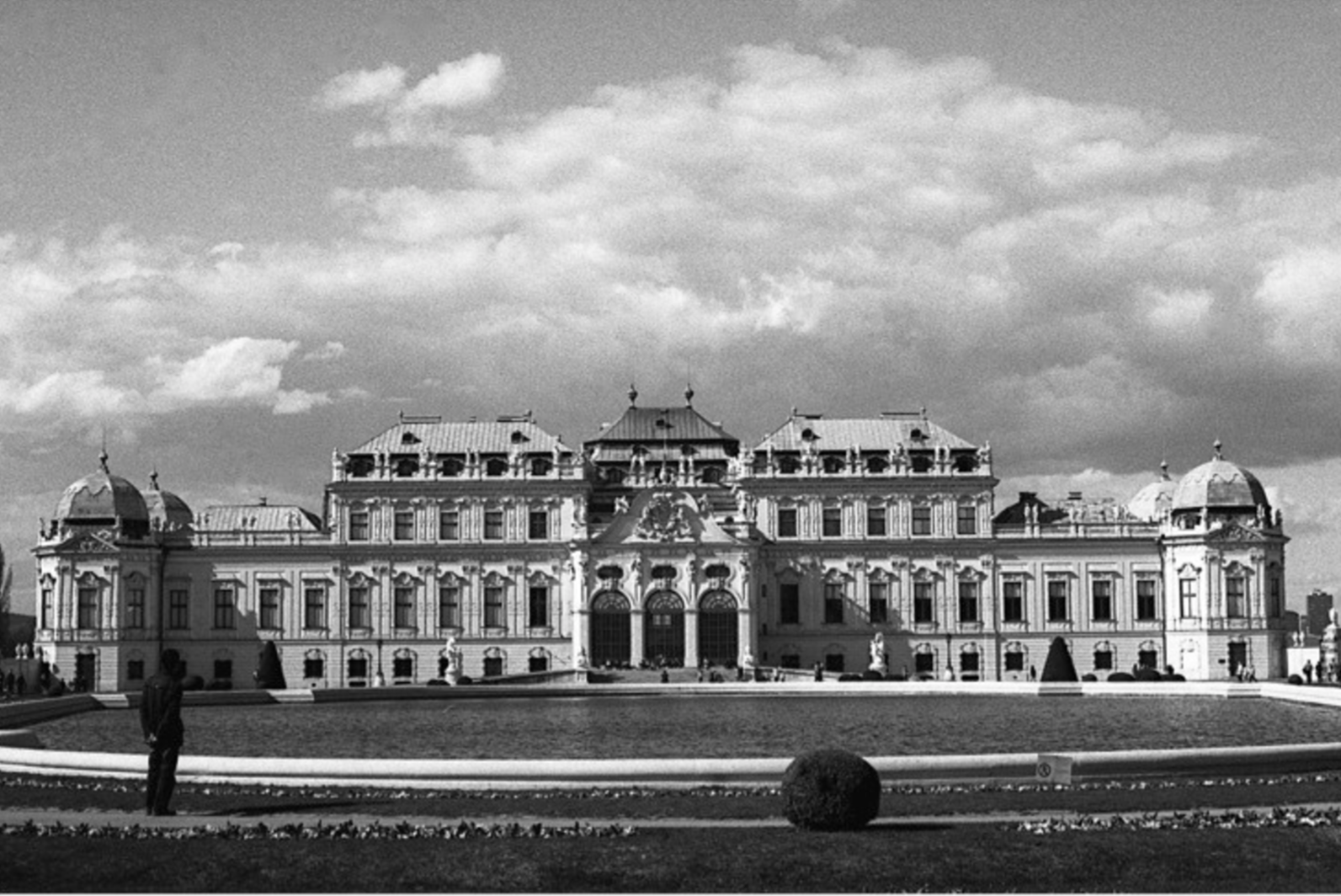A man meditating on the beauty of the Belvedere Palace, Vienna, Austria (April 19th 2013)  //Olympus OM-2N, Fuji Neopan 400, Epson v330// I found this man admiring the Belvedere Palace really beautiful. His aloneness amongst the grandeur of this building made me think of the great capabilities of man to create beauty and how we can sometimes seem small in relation to the things that we have made.