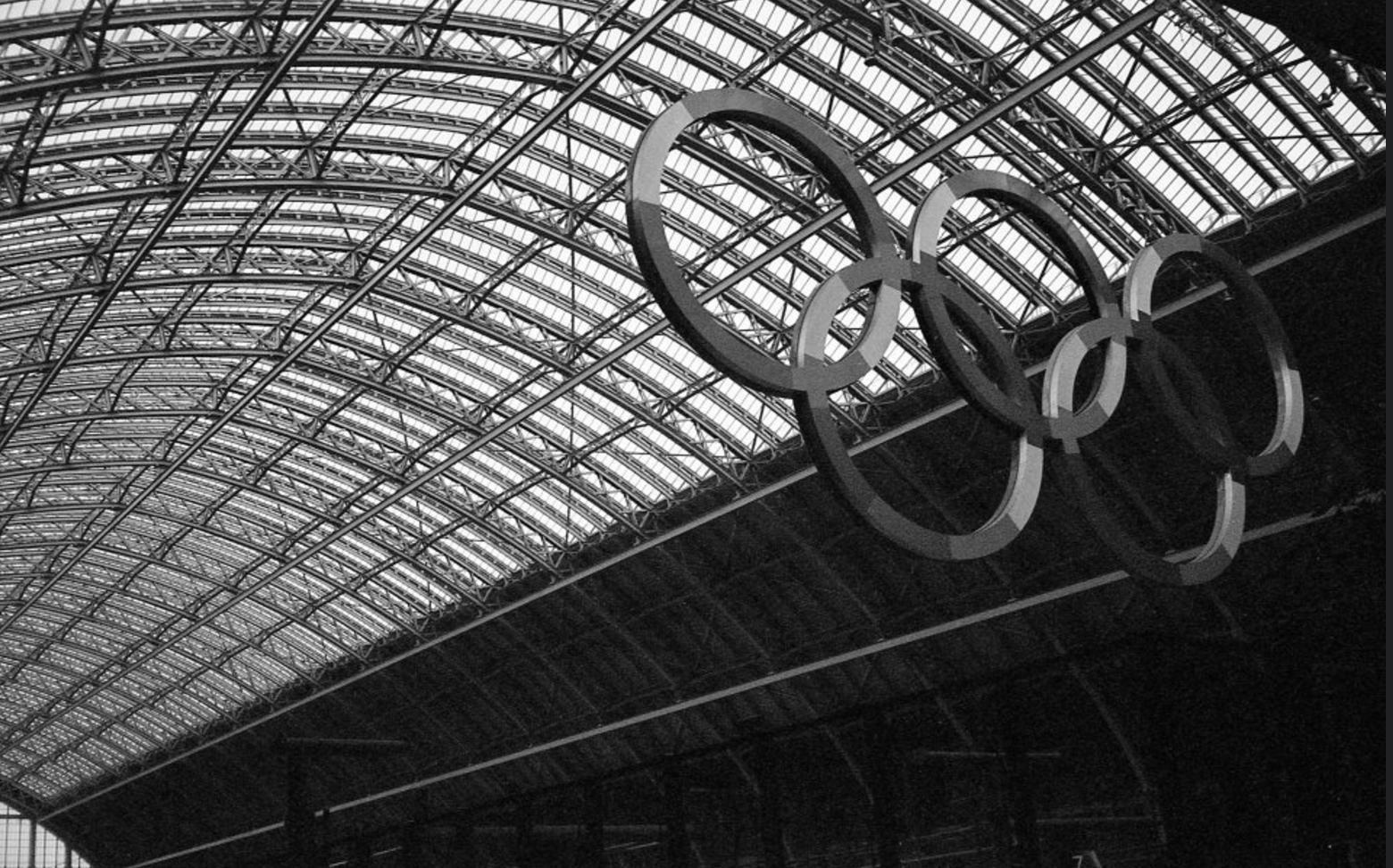 Unity and celebration for the London Olympics, King's Cross St Pancras Station, London, England. (July 20th 2012) //  Minolta Hi-matic AF2, Ilford XP2 400, Epson V330. // The only time of year when the British public spoke to one another on public transport, the 2016 Olympics.
