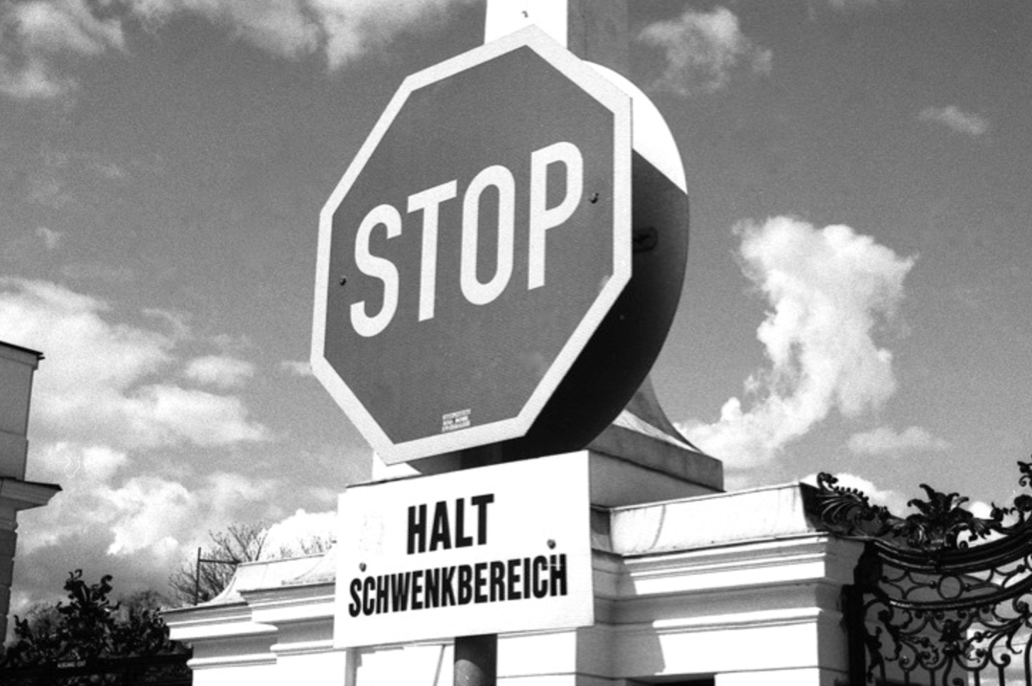 STOP -  the power of the sign, Vienna, Austria. (April 19th 2013)  // Olympus Om-2n, Neopan 400, Epson V330 // Signage is fascinating because there is almost a universal language to it. Even if we removed the words 'stop' the shape of the sign alone says 'stop.' Signs and symbols are unifying and unity is beautiful.