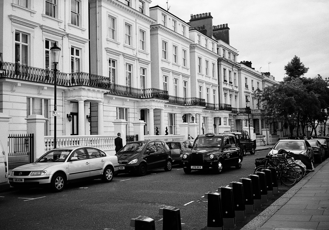 Classic Black Taxi, Notting Hill, London, England (Summer 2012)  // Kodak T- Max 100, Zorki - 4, Epsom V330 // The black cab is to London like the LV logo is to Louis Vuitton.