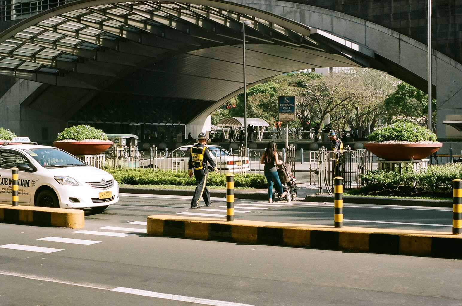 I will take care of you, Makati, Manila, Philippines (Summer 2016)  // Kodak Portra 160, Mamiya ZE-2, Epsom V330 // How can we build communities of kindness? It's quite peculiar because the fact that traffic only stops at a red light if no one is crossing (kind of dangerous) is one of the reason that we have the traffic marshals in the Philippines. Having said that, the fact that the Philippines has less rules also allows drivers to me more hospitable, squeezing on that extra passenger, taking on a chicken, driving a bit above limit, stopping because someone needs to use the bathroom. To what extent do 'too many rules' mean that we don't give as much as we can (obviously without anyone getting hurt.)