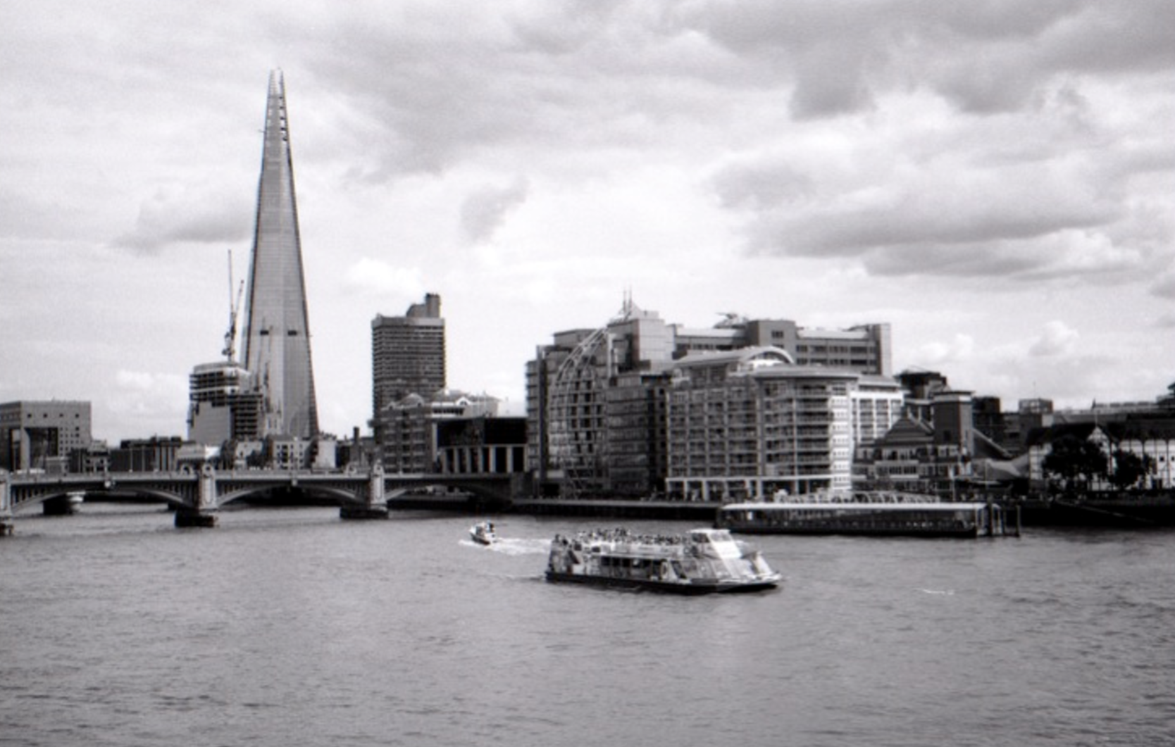 Man built skyline - view from the Millennium Bridge, London, England (Summer 2013) //  Kodak T-Max 100, Olympus OM-2n, Epson V330 // Once a blank piece of land, now home to diverse constructions including the Globe Theatre first opened in 1599 to the Shard designed by Renzo Piano, opened in 2013. I find cities fascinating and love this scene simply because we have so many of London's icons in one frame spanning almost 600 years of history.