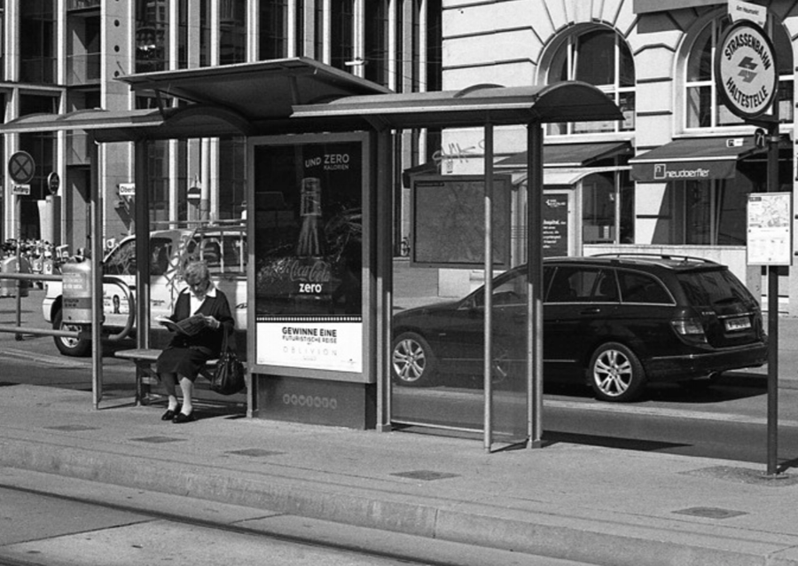 Just waiting, Vienna, Austria (19th April 2013)  // Mamiya ZE-2 , Kodak T-Max 400, Epson V330 // There's a lot of waiting in life. Waiting for the bus, tram, train or taxi. Once we are on a mode of transport, we wait for the journey to end. We wait for the right person to come along. We wait for the rain to stop. We wait for results. We wait for the traffic to pass. We wait for paint to dry. We wait for for the supermarket queue to progress. Why do we spend so much time waiting? How can waiting time be used to enrich our experience of life?