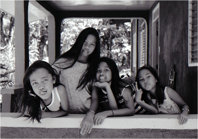 Young, Ragay, Camarines Sur, Philippines (Summer 2013)  // Ilford HP5, Mamiya ZE-2, Epson V330 // When we create, me must preserve what is most precious about the human experience, the essence of the childhood spirit — connection, fun and joy.  If we do not create for this purpose, why are we creating at all?