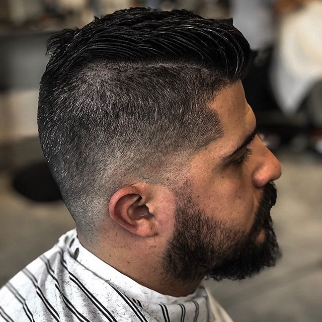 Low zero fade with a pompadour.  Styled with Layrite Grooming Spray and Cement Clay.