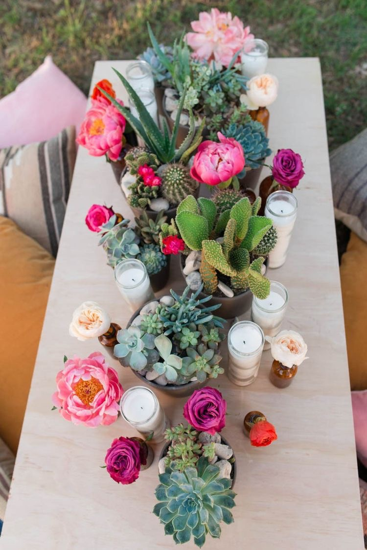 Boho - At boho style weddings you often see vibrant colored flowers. To do something a bit different, you could add succulents to each table, with candles and other flowers.