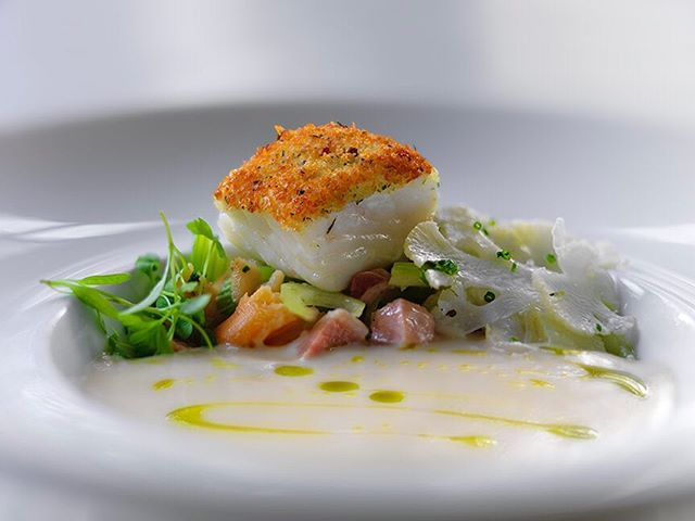 Herb Crusted Halibut, Cauliflower Velouté, Braised Bacon, Chowder Vegetables, Locally Dug Clams. #deuxave