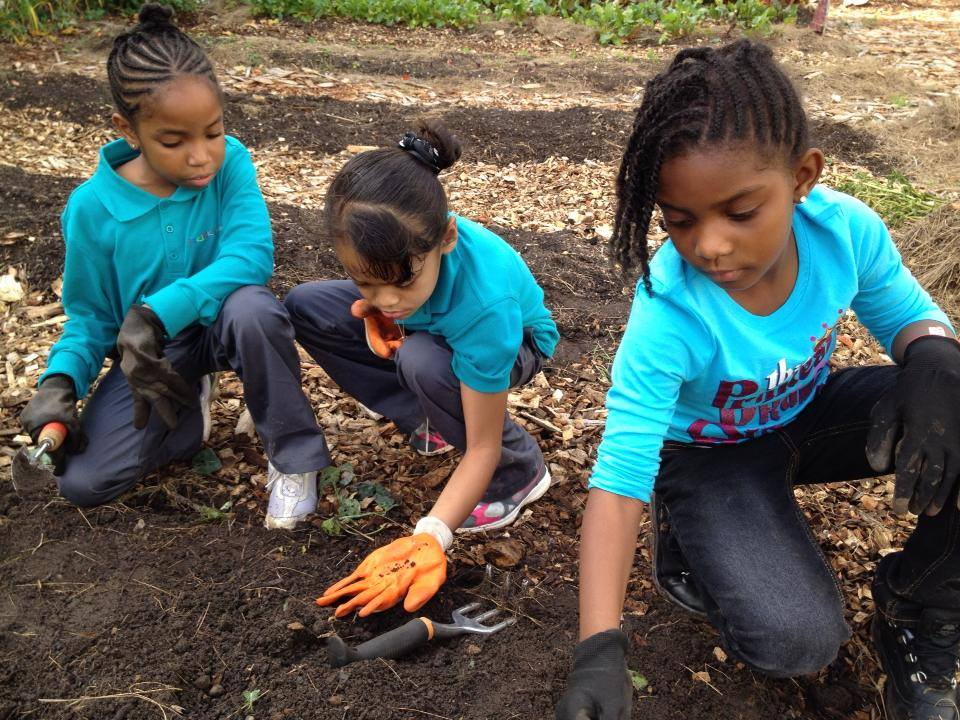 Swag Project- girls planting.jpg