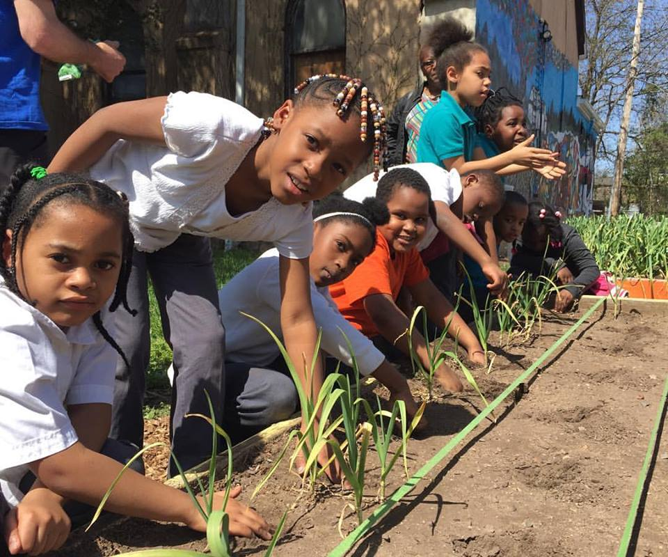 Swag Project- kids planting.jpg