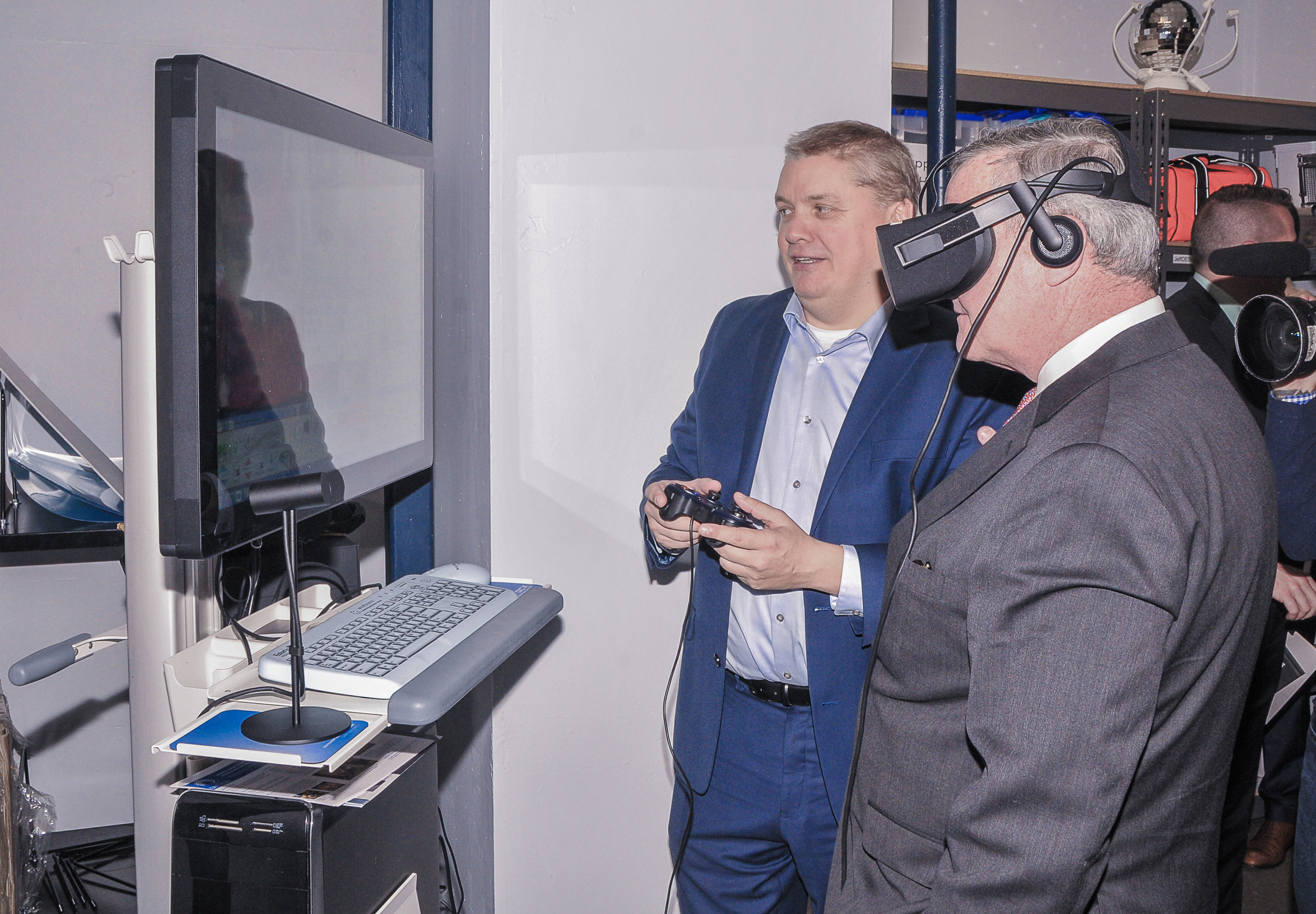 Mayor Kenney testing out a virtual reality surgical training simulator.