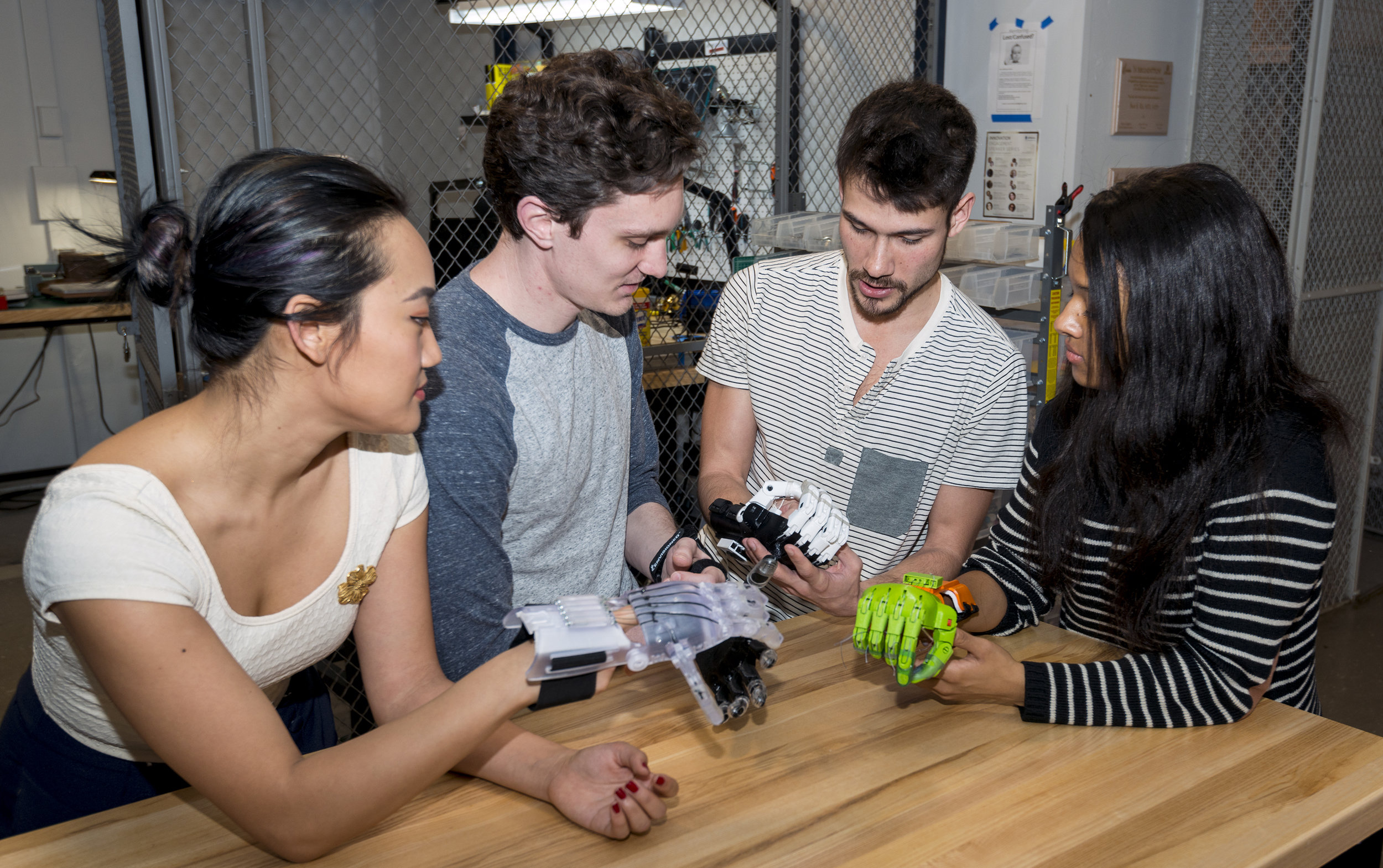 JeffDESIGN Medical Students, testing out a few different versions of 3D printed prosthetic hands, including a robotic hand that can be produced at a fraction of the cost of commercial robotic prosthetics.