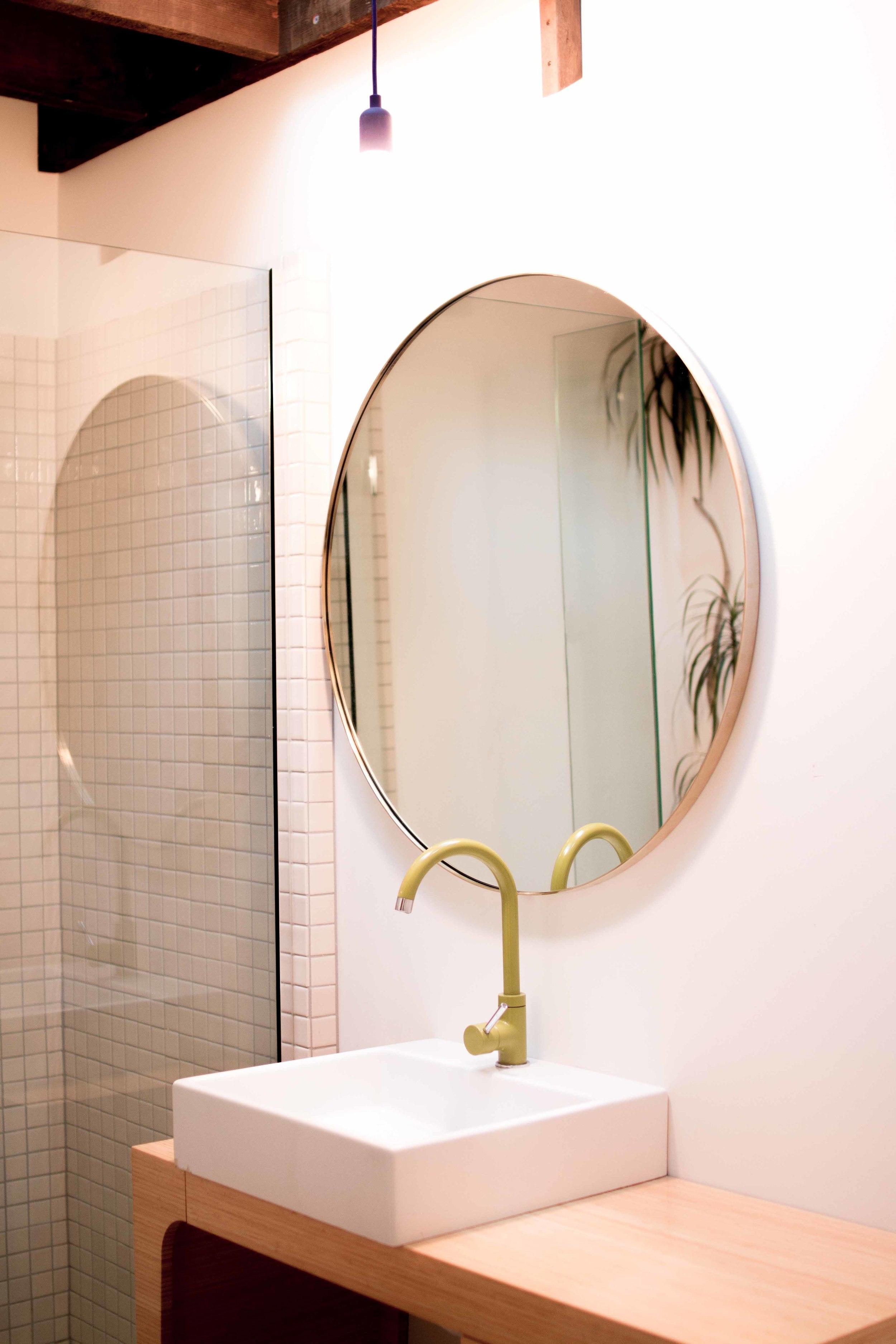 brass mirror bathroom.jpg