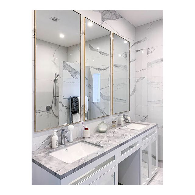 Always nice to see where our mirrors end up. These were custom made for @venia_design to their design and specs.  #madetomeasure #customwork #brassnglass #marble #bathroom #mirrors