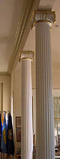Decorative columns  enclosed supporting timbers and replaced room partitions.