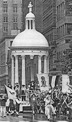 "For the Constitution's Bicentennial parade in Philadelphia (1988), the Carpenters' Company re-created the original Federal Edifice. The cupola represented the new central government. Ten states which voted for ratification received columns; space for the three which had not yet voted (New York, Rhode Island and North Carolina) remained vacant. Carved in the float's base was a motto which still resonates: ""In Union the Fabric Stands Firm."""