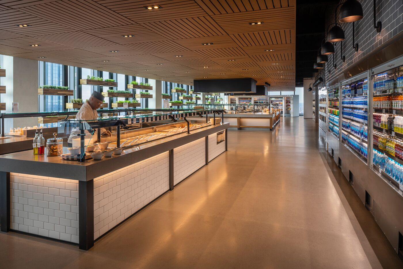 """The Market"" accommodates a wide array of self-serve food stations that offer a range of food from pizza to sushi. They also have on display, a wall of fresh herbs, pictured top left."
