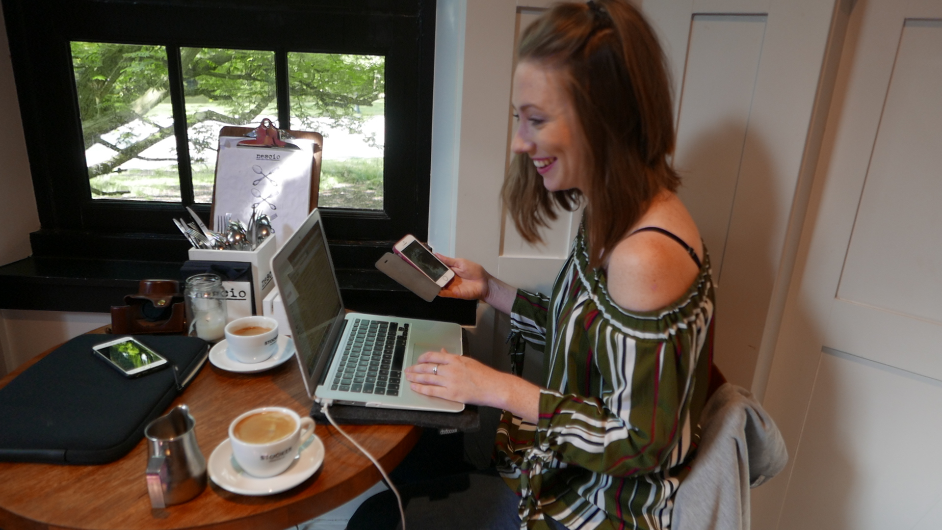 Nat taking her work VERY seriously in a co-working spot in Amsterdam East (whilst also dual screening)