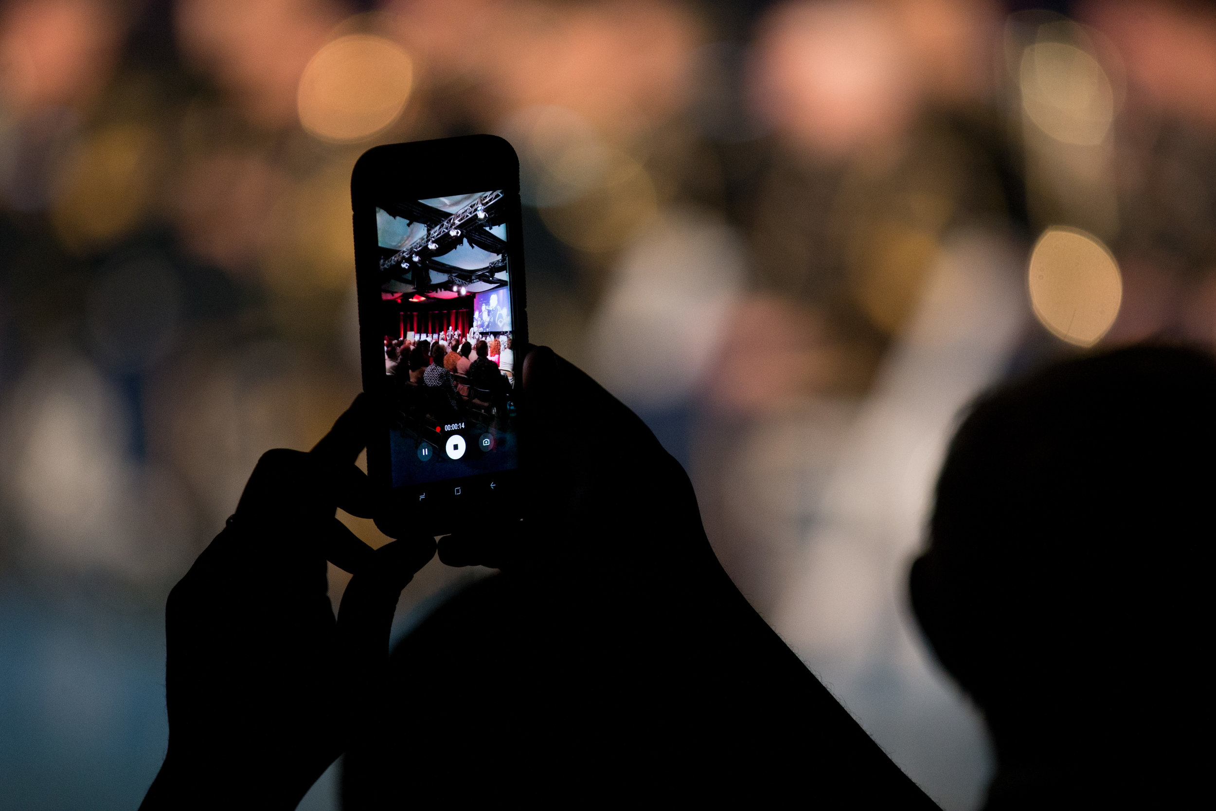 A concert goer records the performance with a cell phone at a U.S. Army Band concert in Arlington, Virginia.