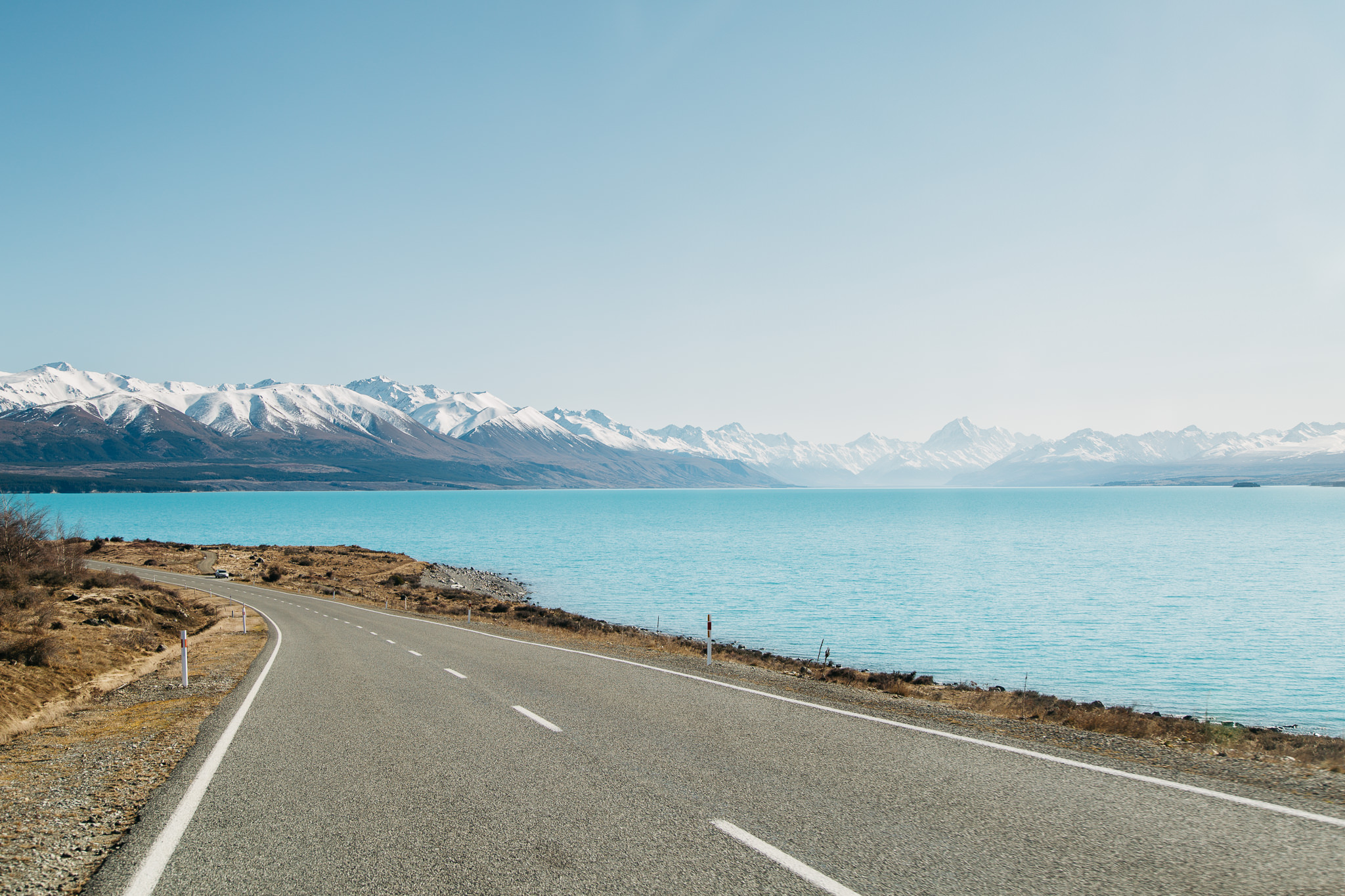 Road in front of Lake Pukaki in the South Island of New Zeland with Mount Cook in the background