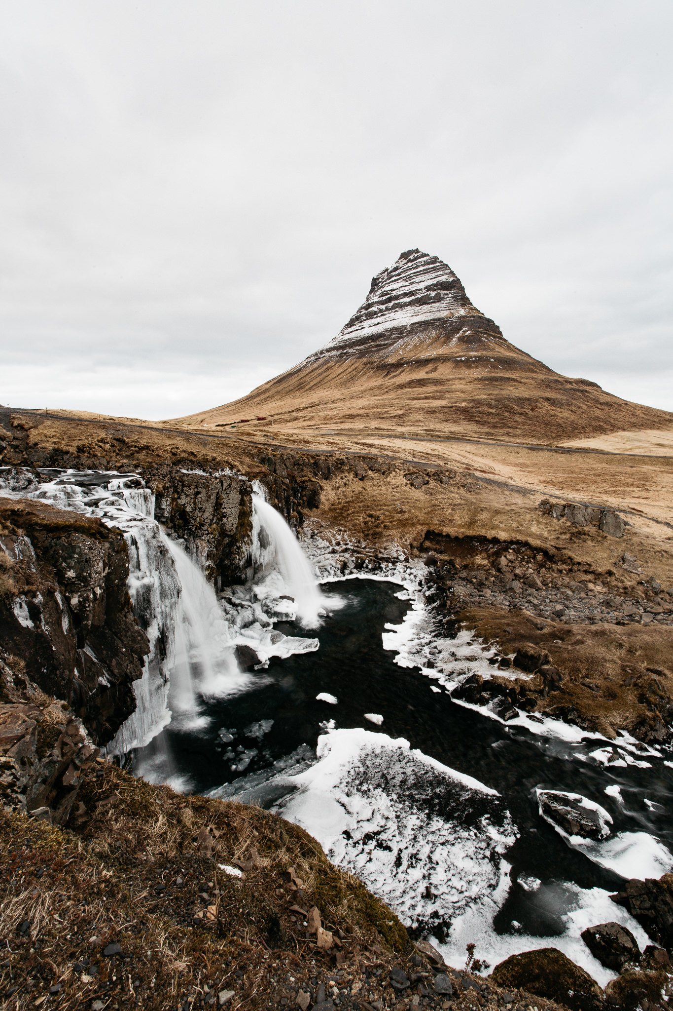 Kirkjufell mountain with two waterfalls in the foreground
