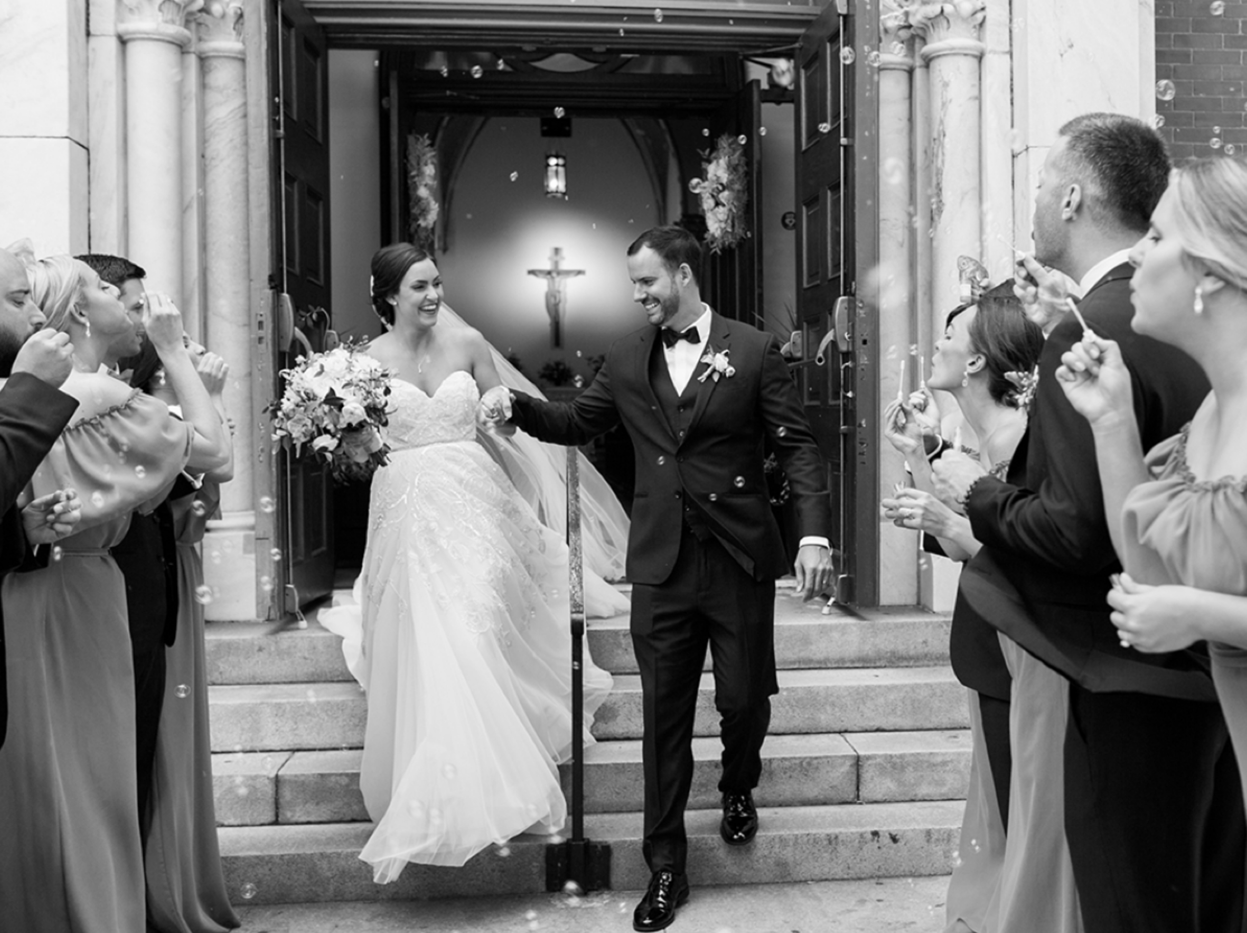 ceremony_exit_with_bubbles_west_palm_wedding_photographer_shannon_griffin.png