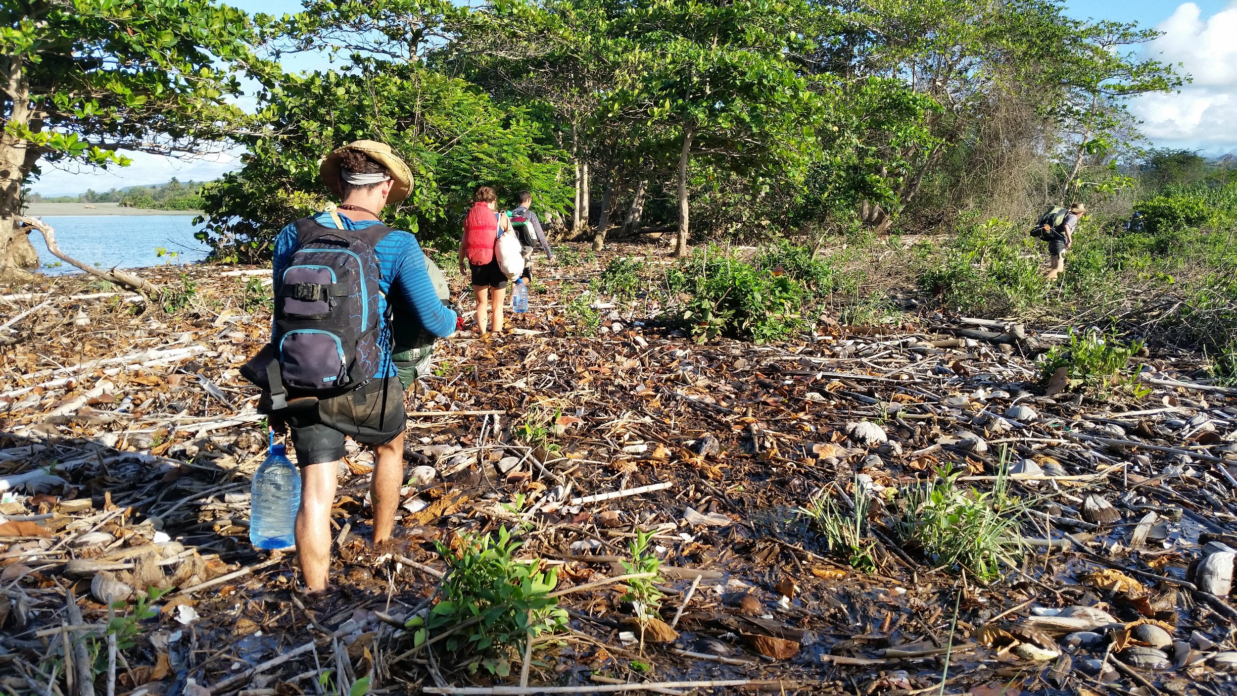 Hiking through thousands of coconut shells and a flooded coast to our next site