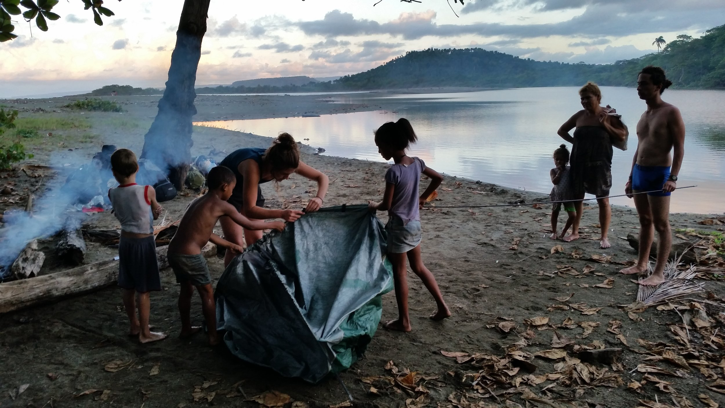 Local kids help us pitch our tent