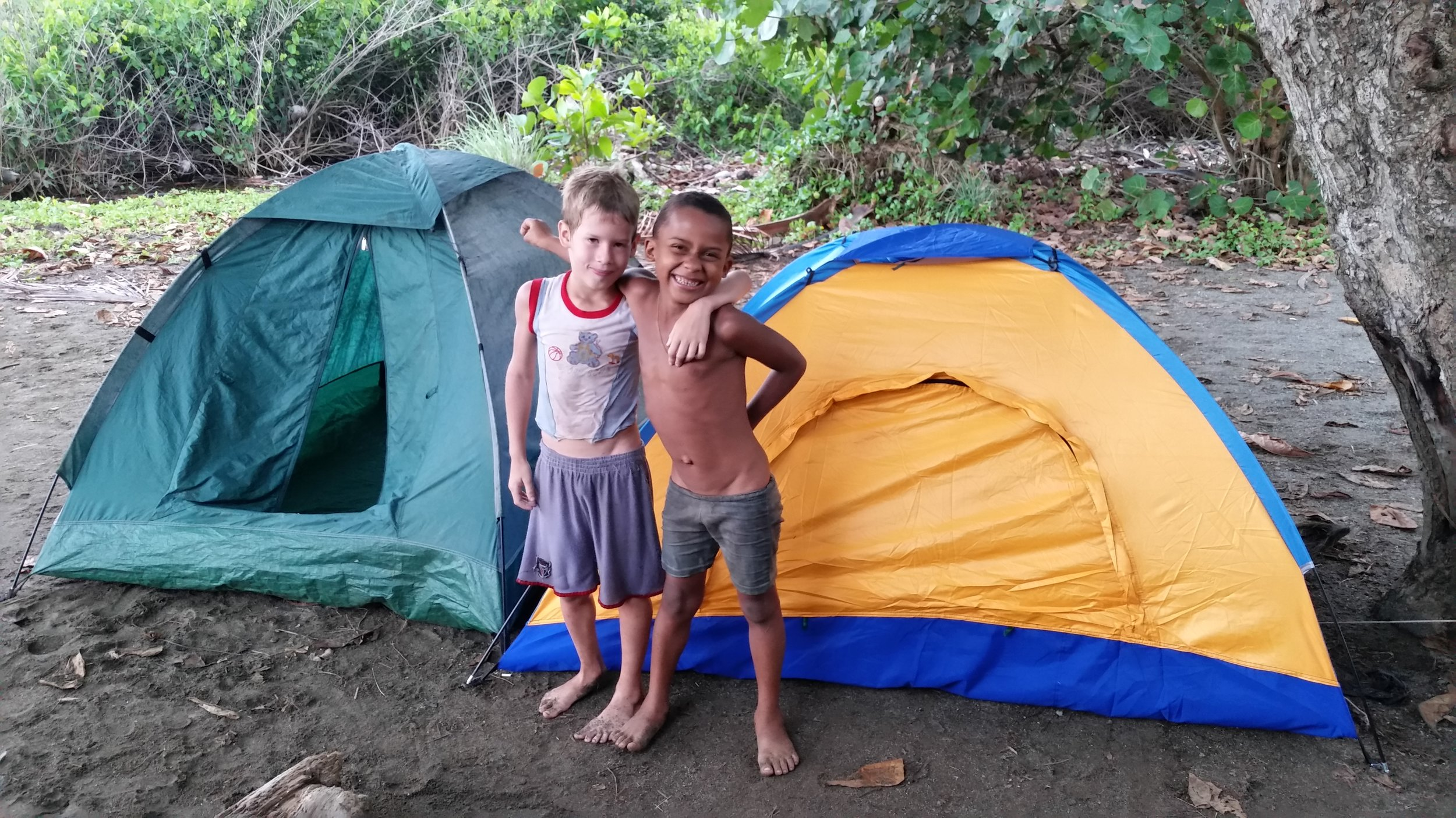 Two helpers very proud of helping pitch the tents