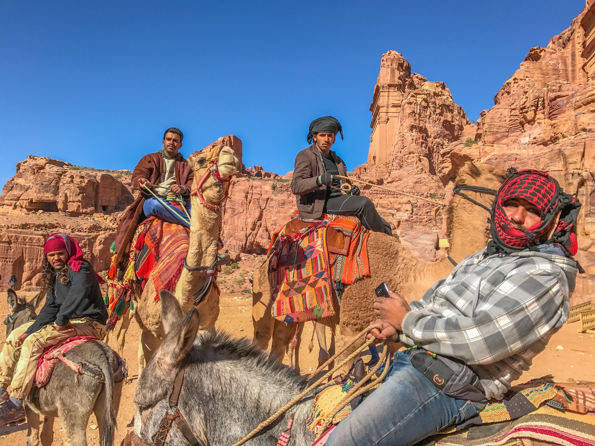 "Petra Camel drivers, all wearing ""Pirates of the Caribbean"" eyeliner"