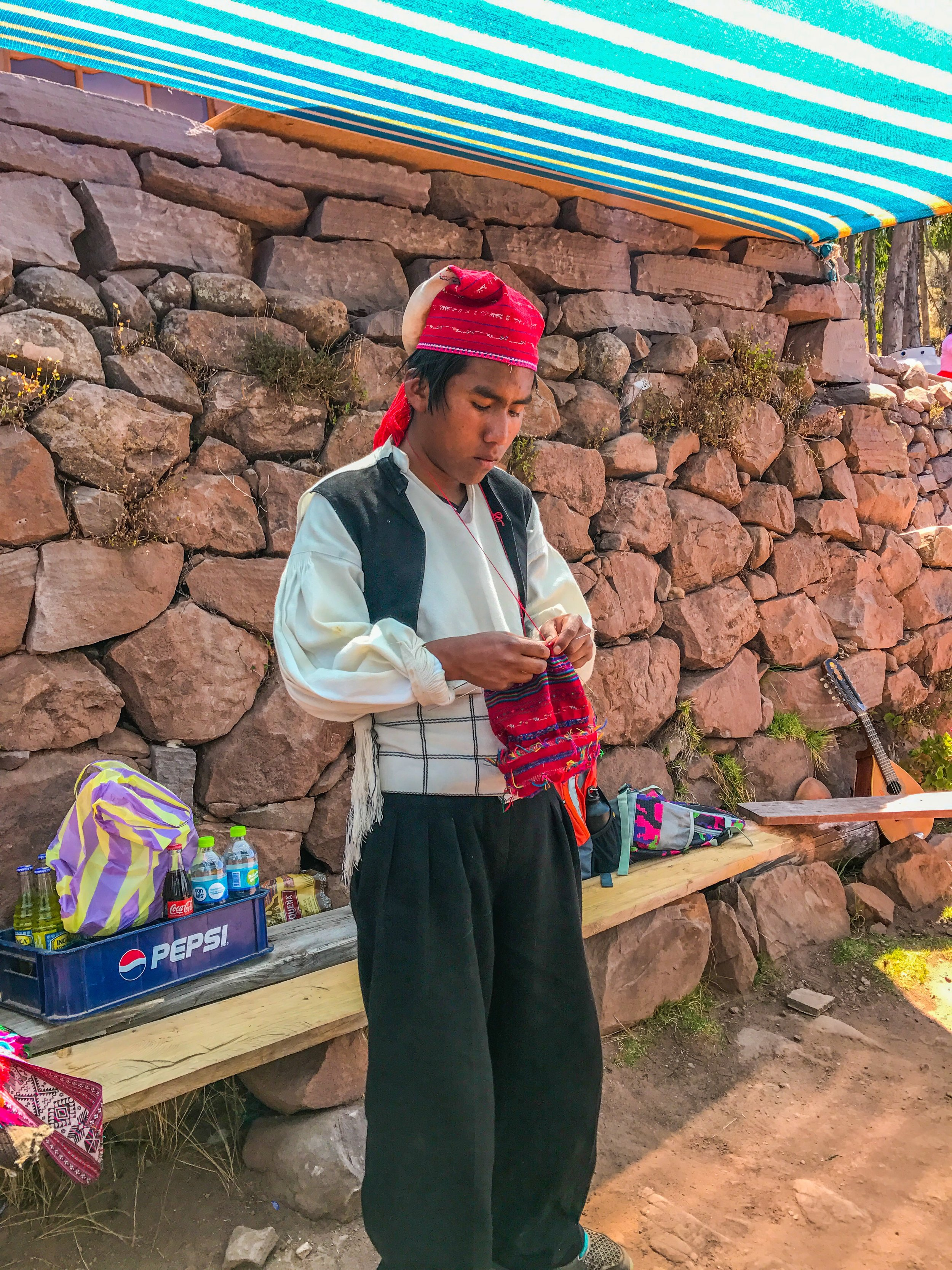 A young (and single) Taquile boy demonstrates his knitting skills