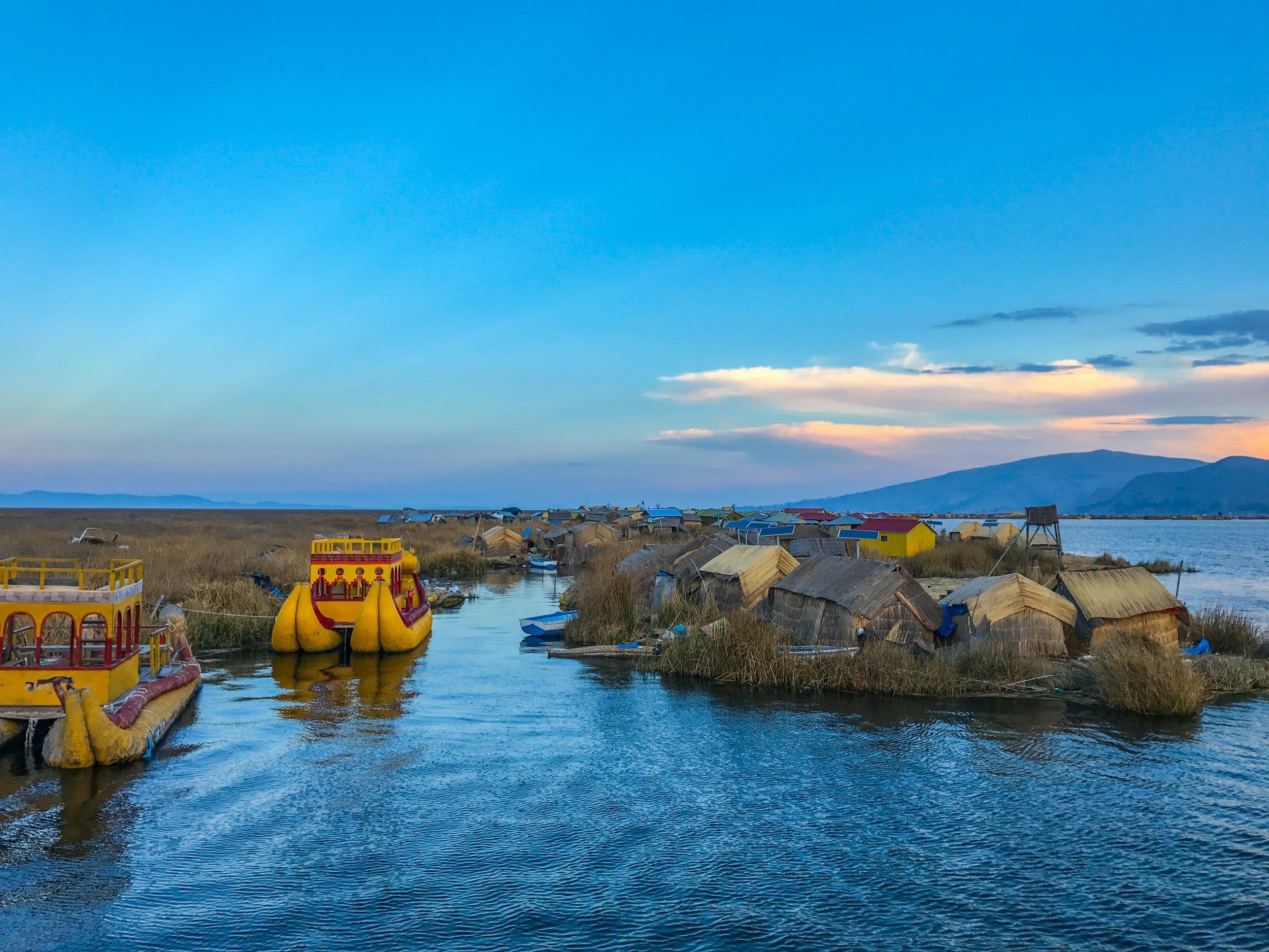 A small Uros island and its boats near Puno, Peru