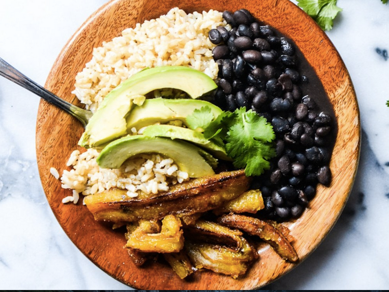 This is not really Cuban. Brown rice is rare, these are Mexican avocados (Cuban avocados are only in season July-Nov anyway), and Cuban food rarely is garnished with fresh herbs