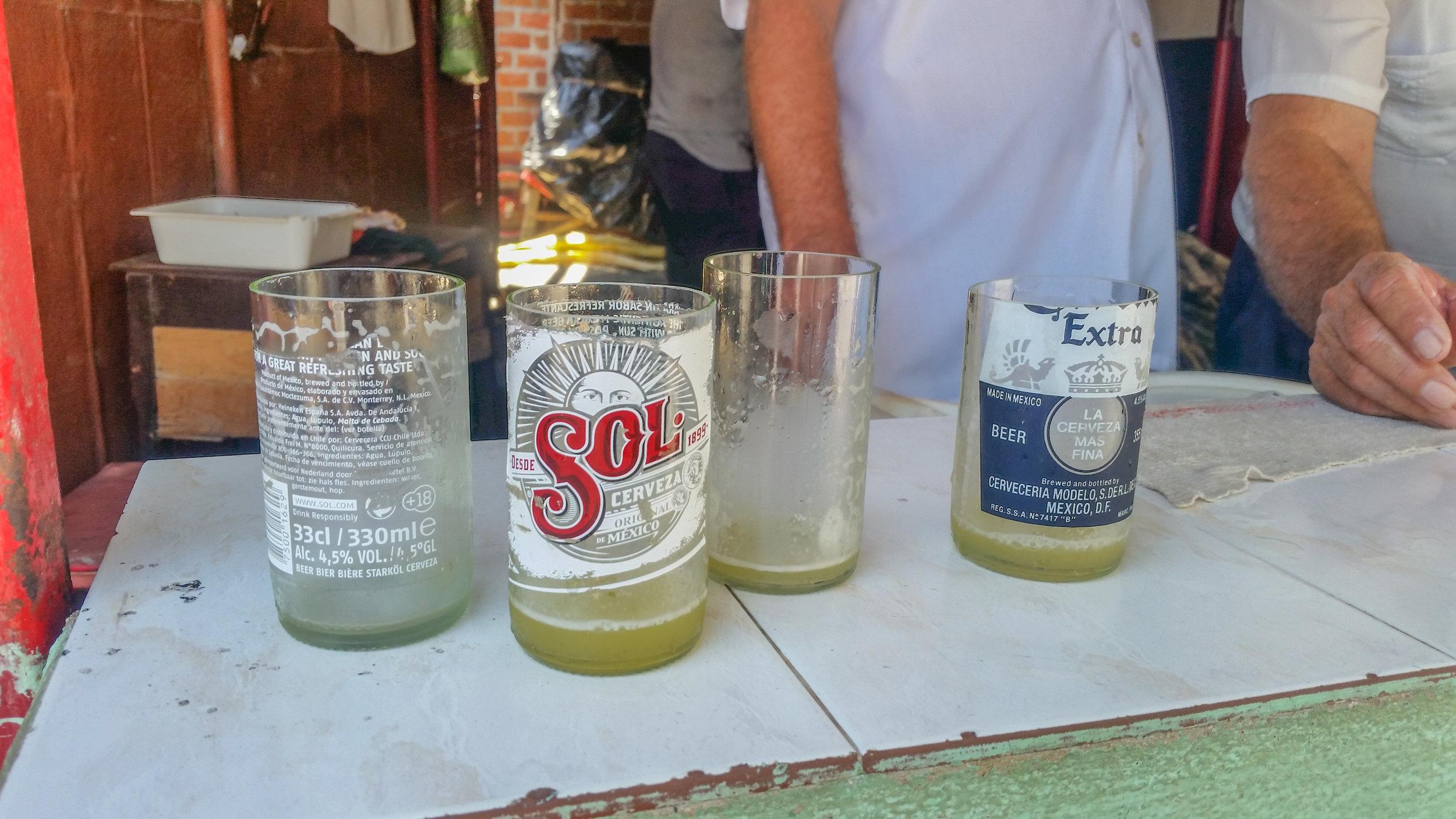 Sawed-off beer bottles make great sugar cane juice cups in Bayamo, Granma