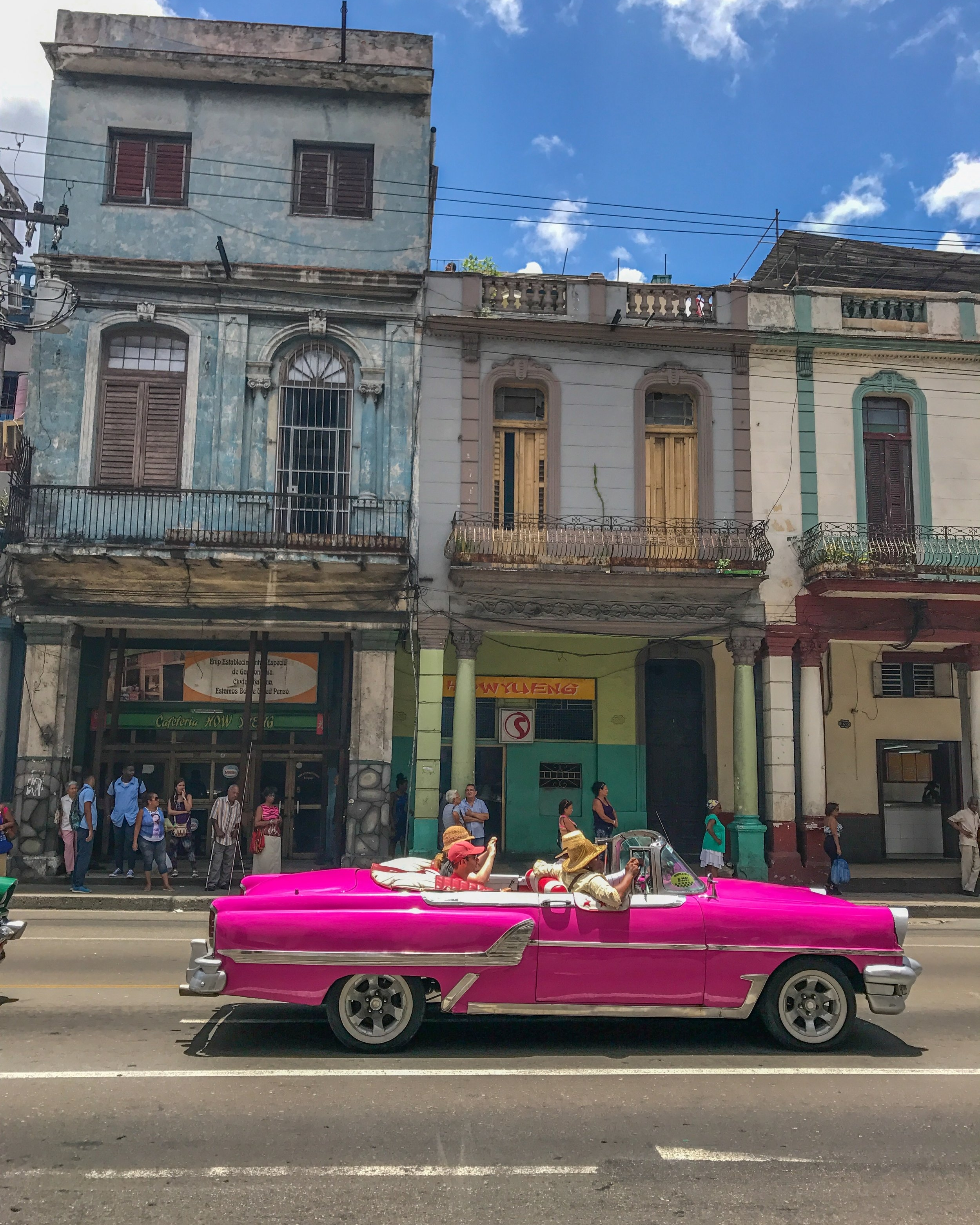 Classic car tour through Central Havana