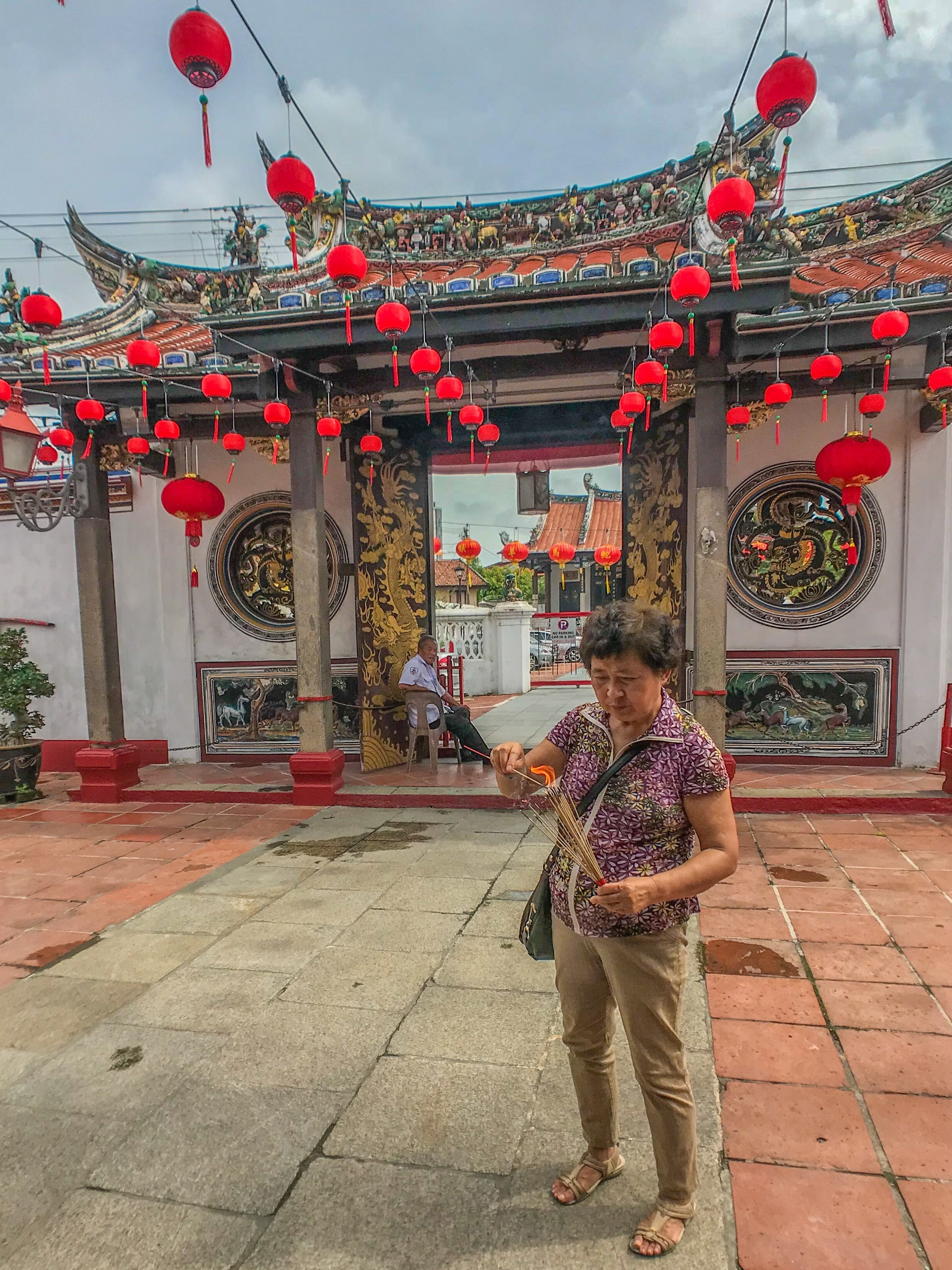 Preparing an offering at a temple in Melaka