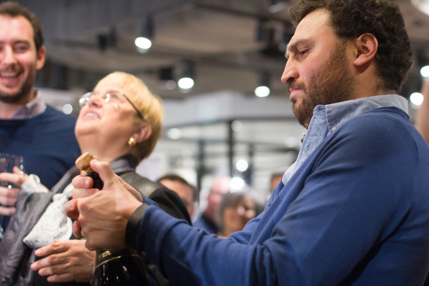 Eataly CEO Nicola Farinetti celebrates Tuesday's ribbon cutting ceremony by opening a bottle of champagne.