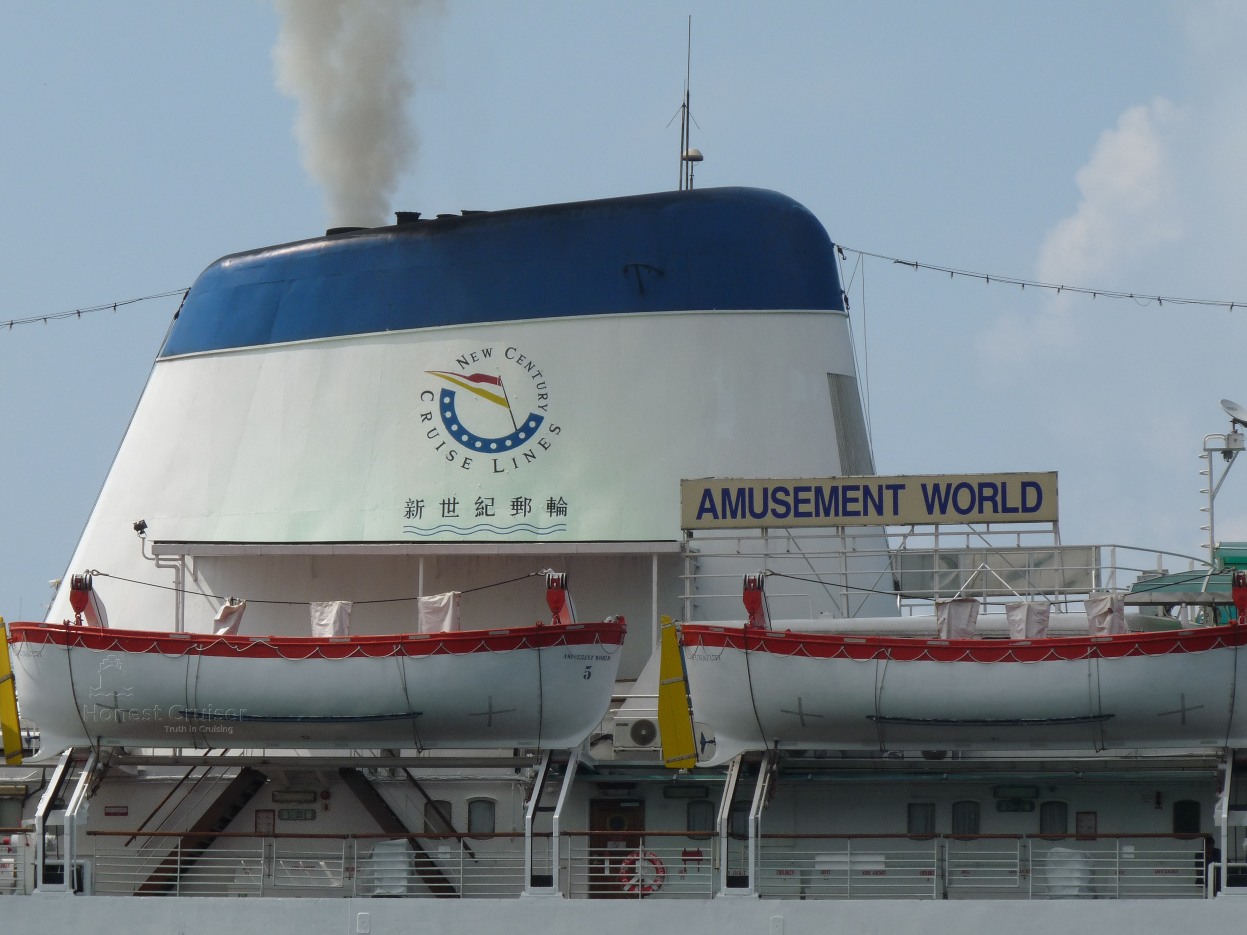 Amusement World's funnel in full use with New Century Cruise Lines logo prominently displayed.