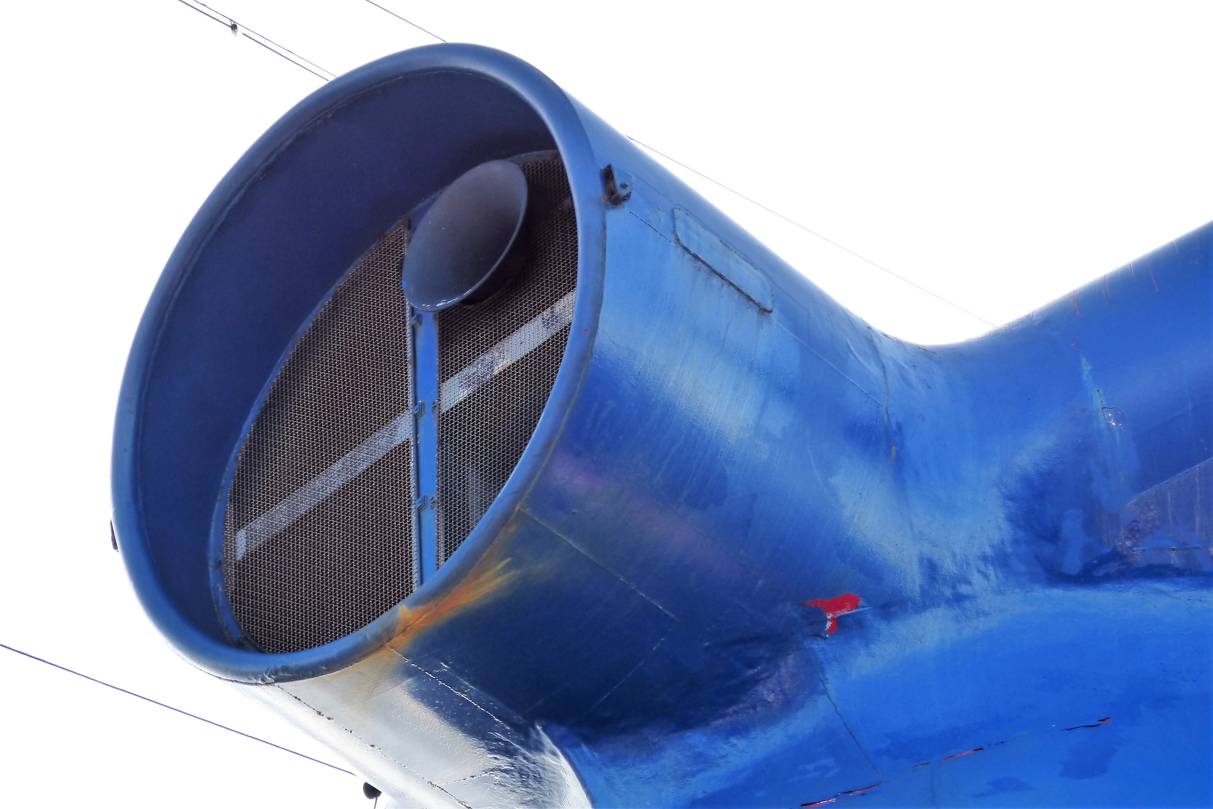 Under the funnel air intake, the blue paint is peeling to reveal the original Carnival red.