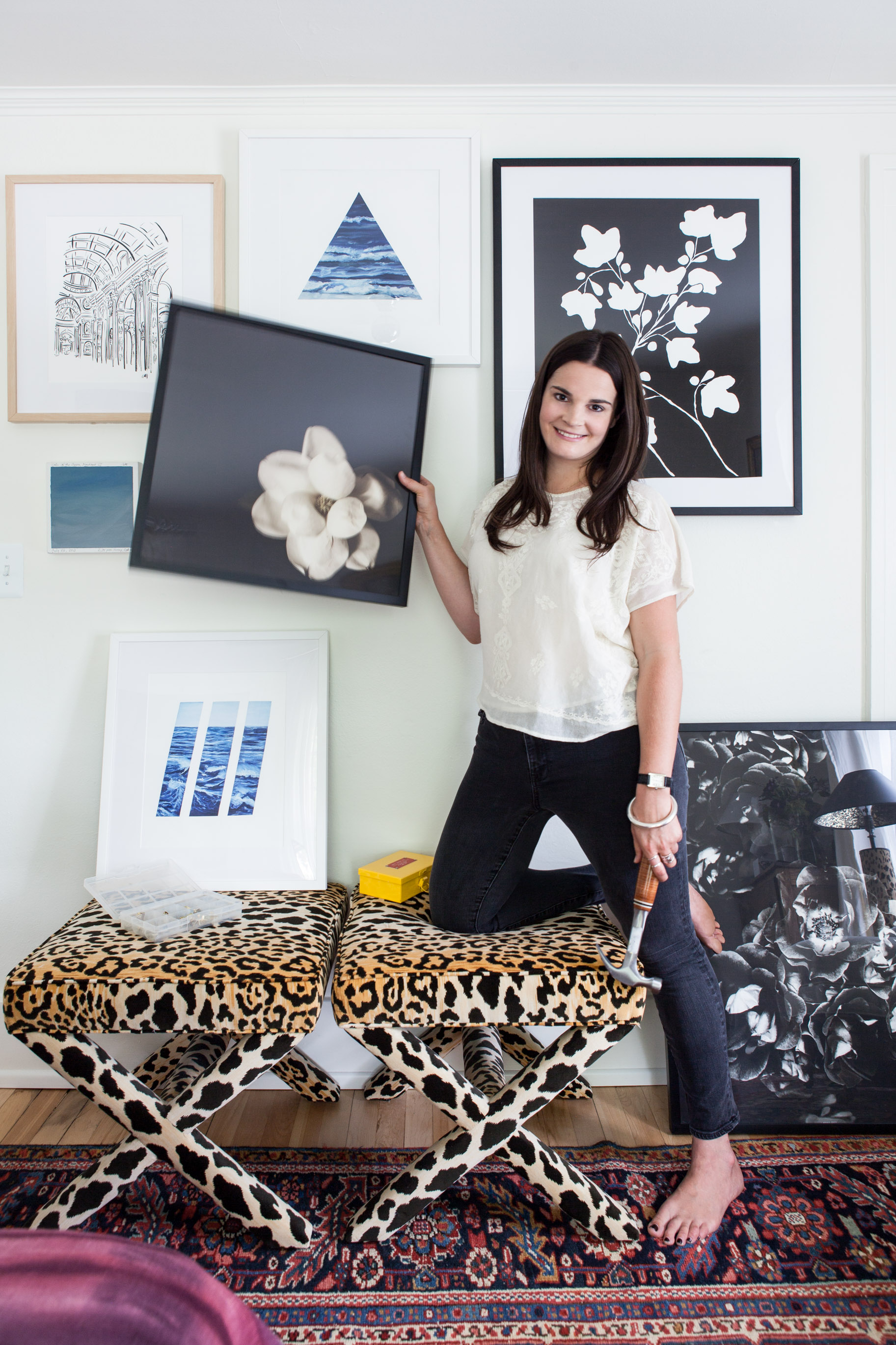 Michelle at home with a collection of pieces from Artfully Walls. Photo by  Marta Xochilt Perez .