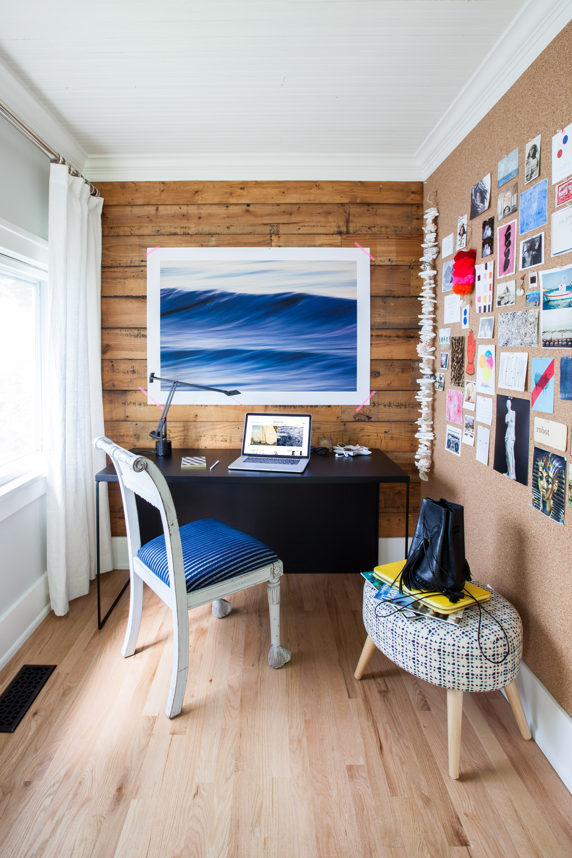 Michelle's home office, featuring  Waves II by Greg Anthon . Photo by  Marta Xochilt Perez .