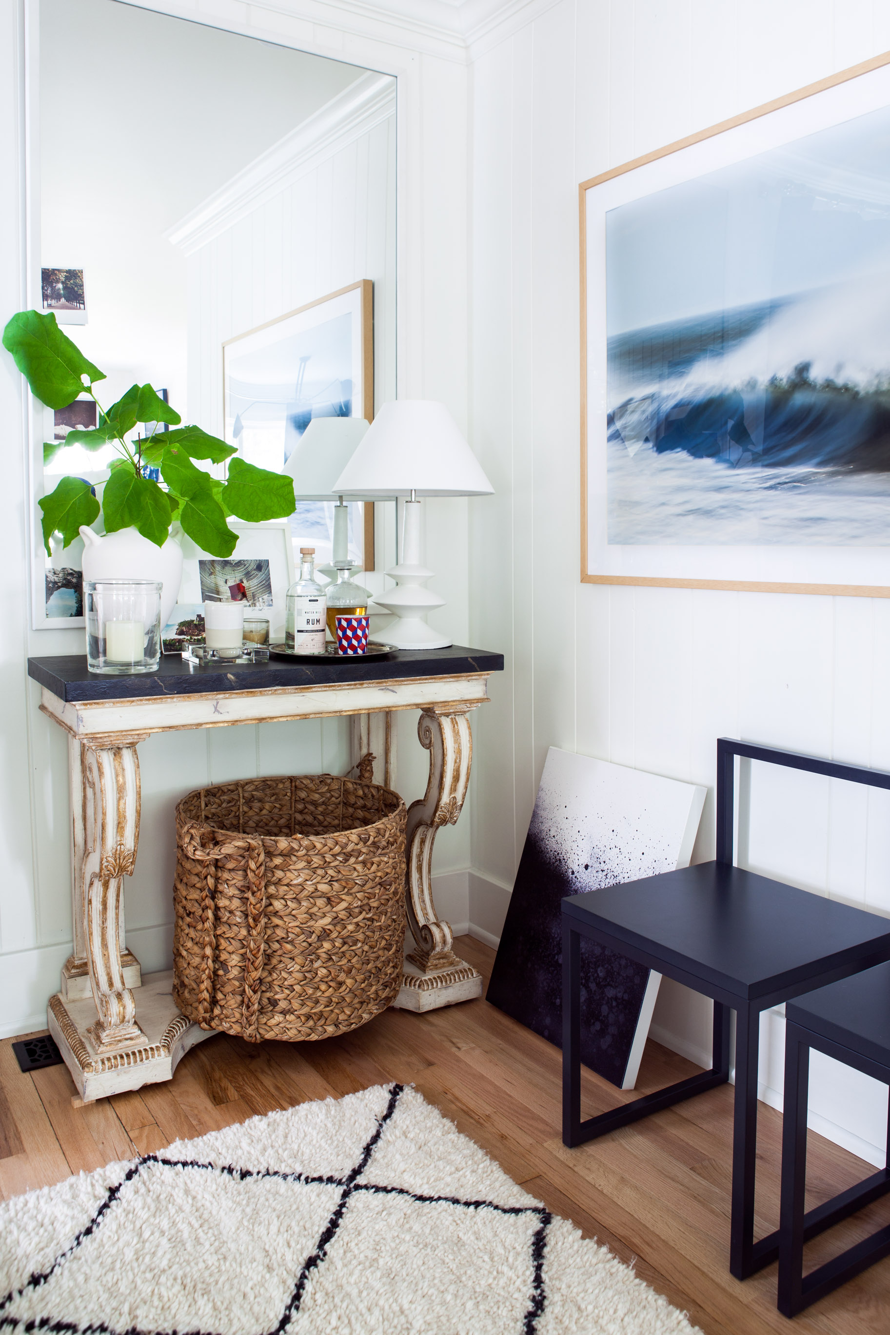 As a fan of seaside living, Michelle gravitates toward art depicting water. Above in her living room she pairs  Waves with Spray by Greg Anthon  with  Escape by Elaina Sullivan . Photo by  Marta Xochilt Perez .