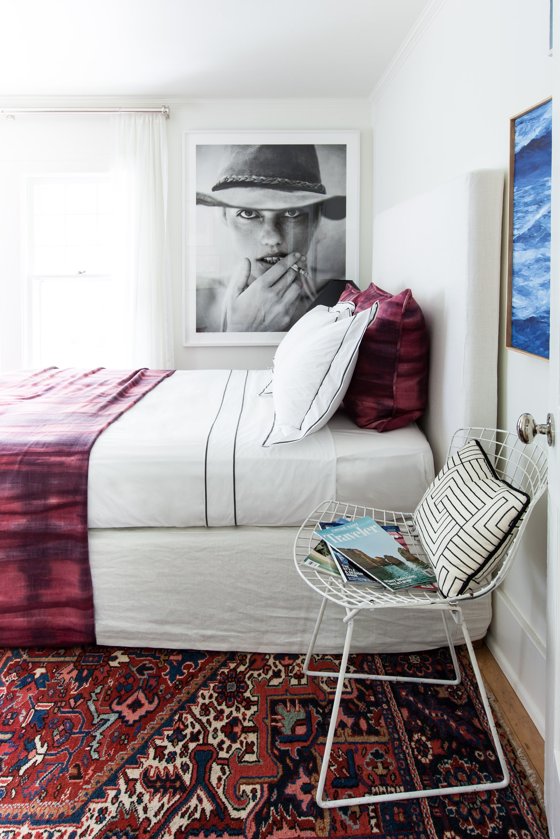 In her guest room, Michelle uses an oversize photograph to create an immediate focal point. Photo by  Marta Xochilt Perez .