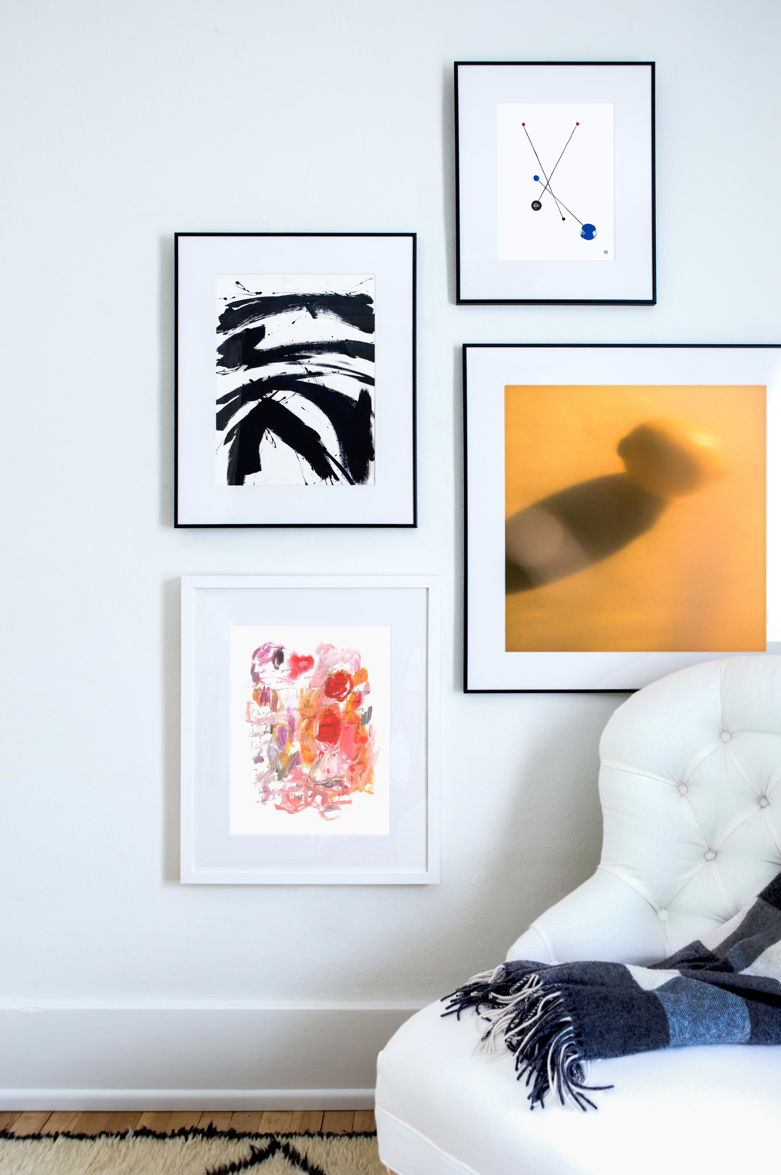 (From top to bottom)  2 black 2 red 2 blue  by  Skye Schuchman ,  B + W #3  by  Jill Sykes ,  Citrus  by  Erik Melvin , and  Chapter Three: no chapter three.  by  Kelly Witmer . Photo by  Marta X. Perez  for Artfully Walls.