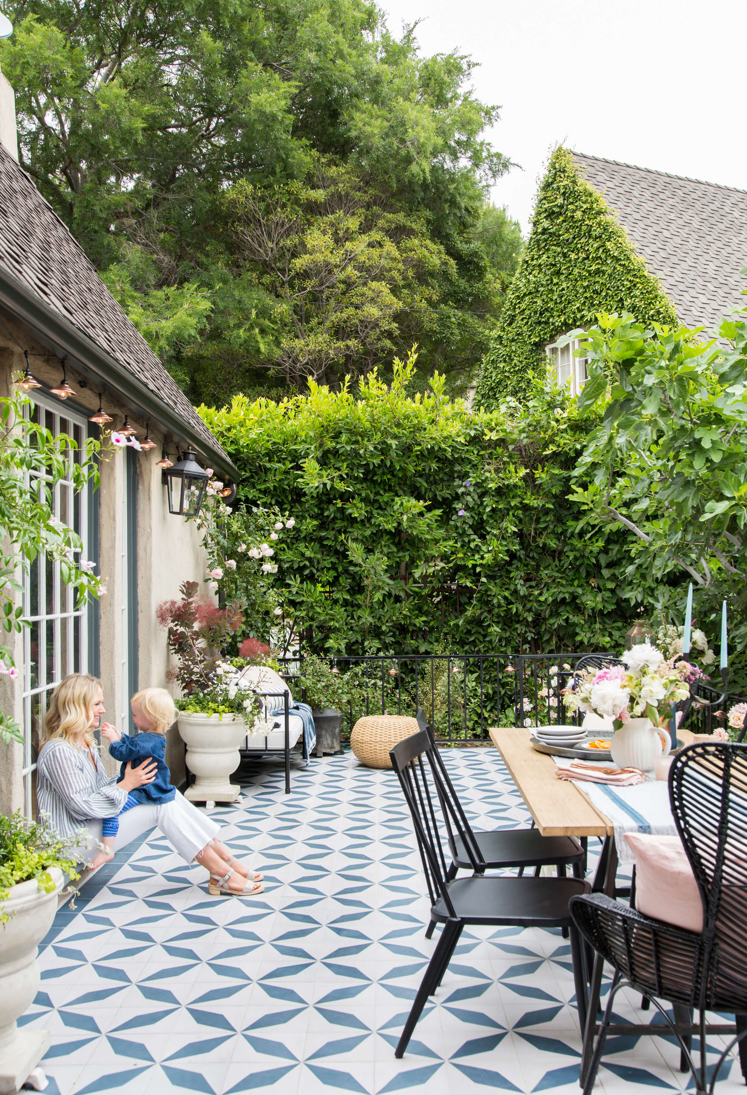 Designer  Emily Henderson  on her patio with tiles by  Granada .