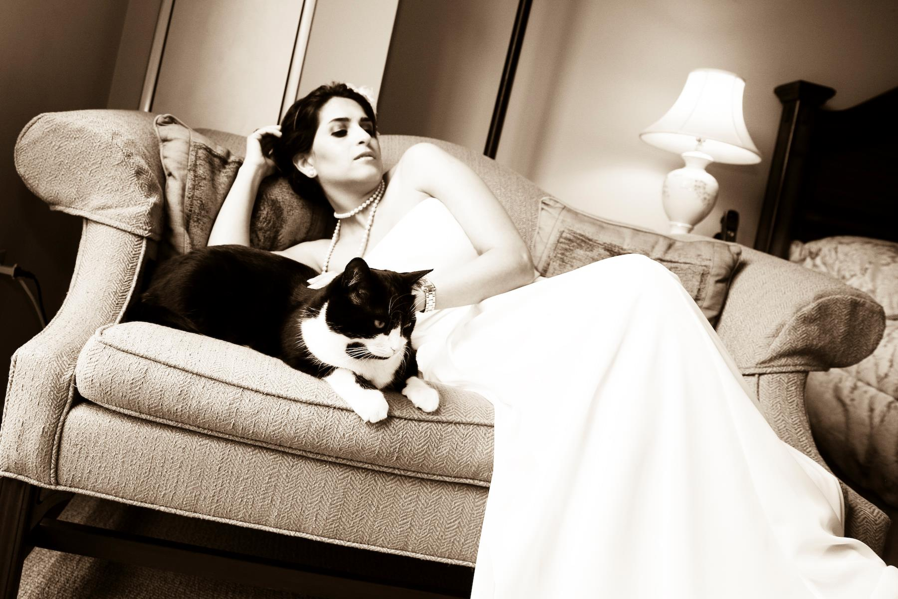 Bride and her kitty cat on couch