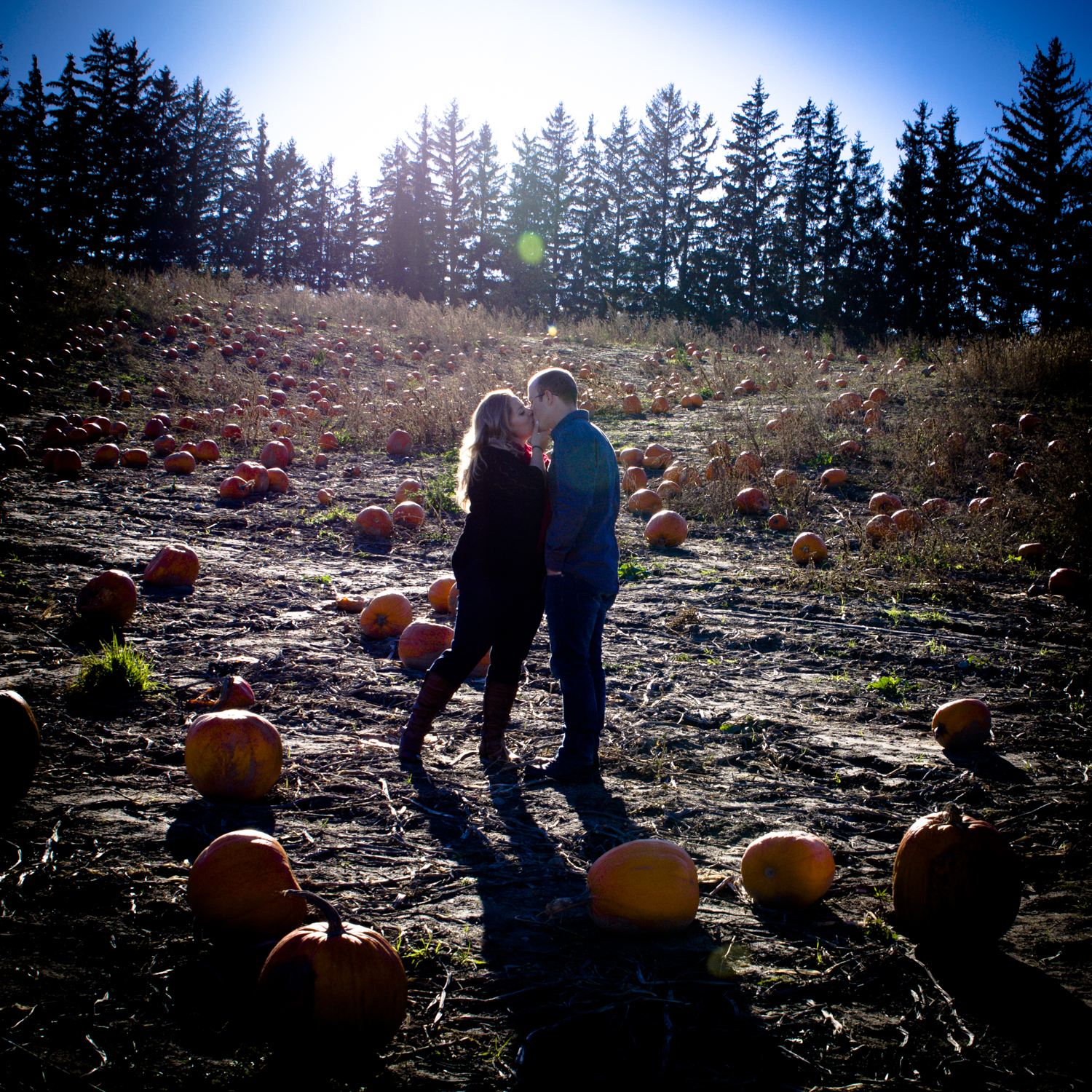 October fall engagement photo with pumpkins